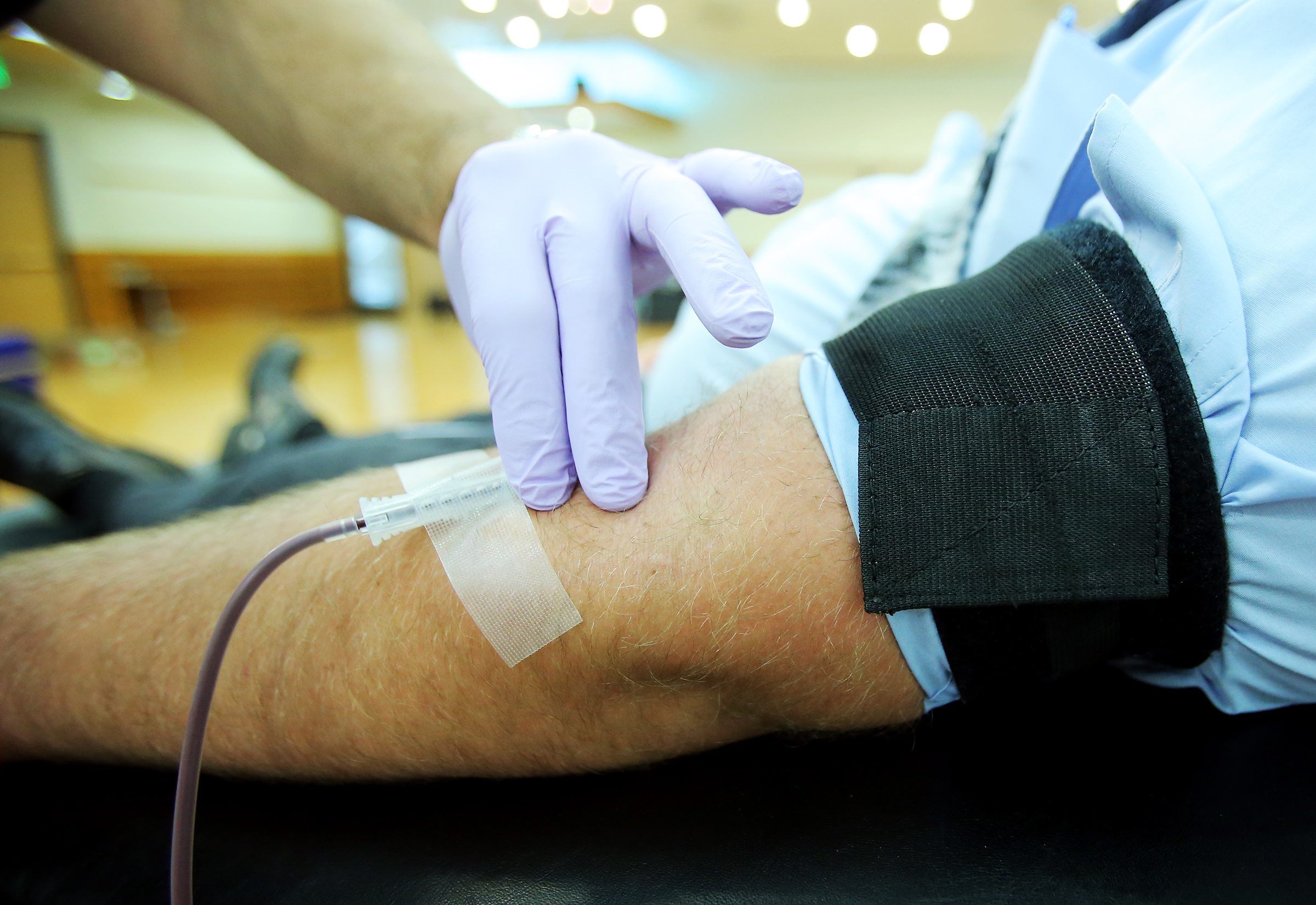 American Red Cross phlebotomist Alex White holds a needle in Brock Liston's arm steady as Liston donates blood at Salt Lake Community College in Taylorsville on Tuesday, June 11, 2019.