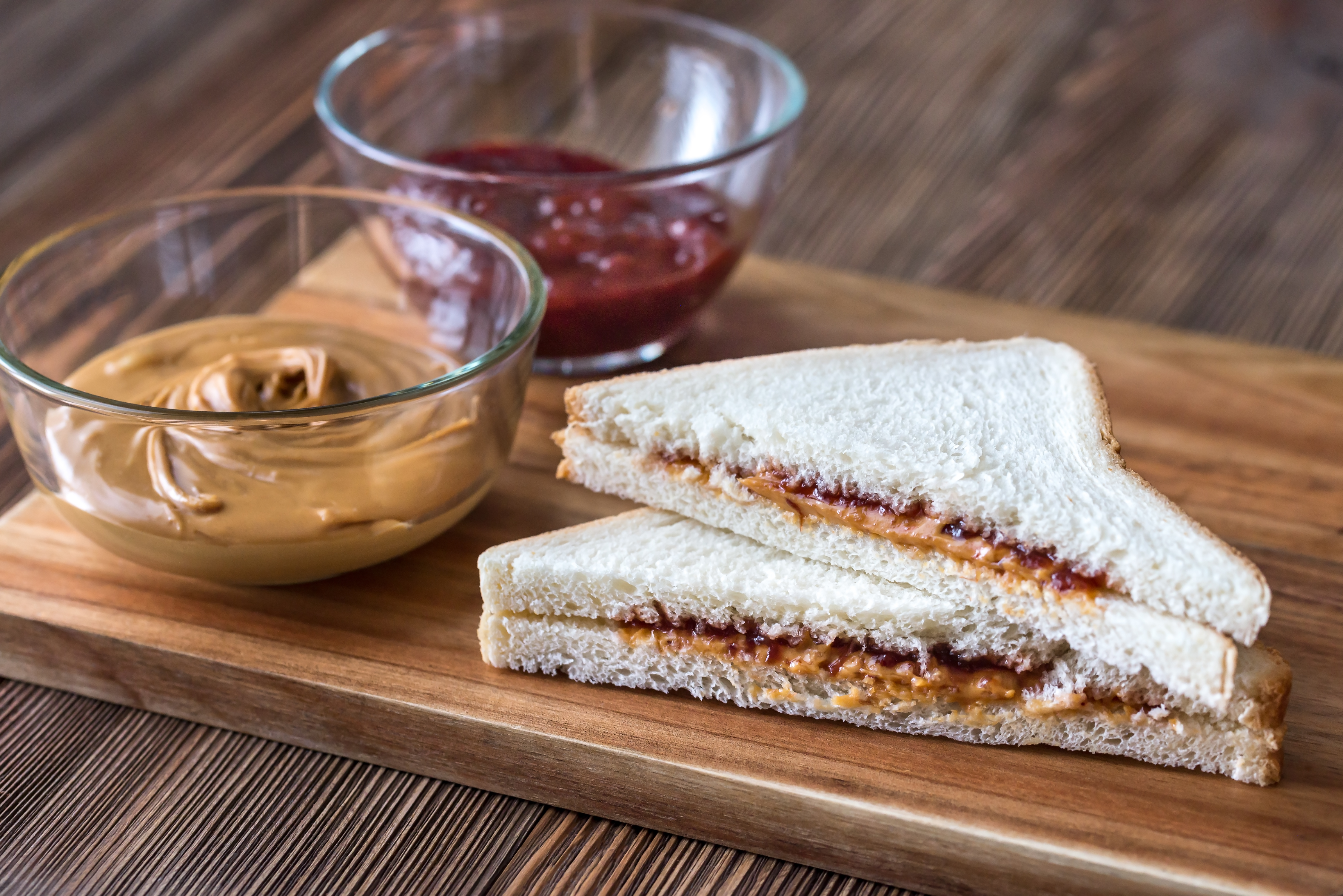 A stock image of a peanut butter and jelly sandwich