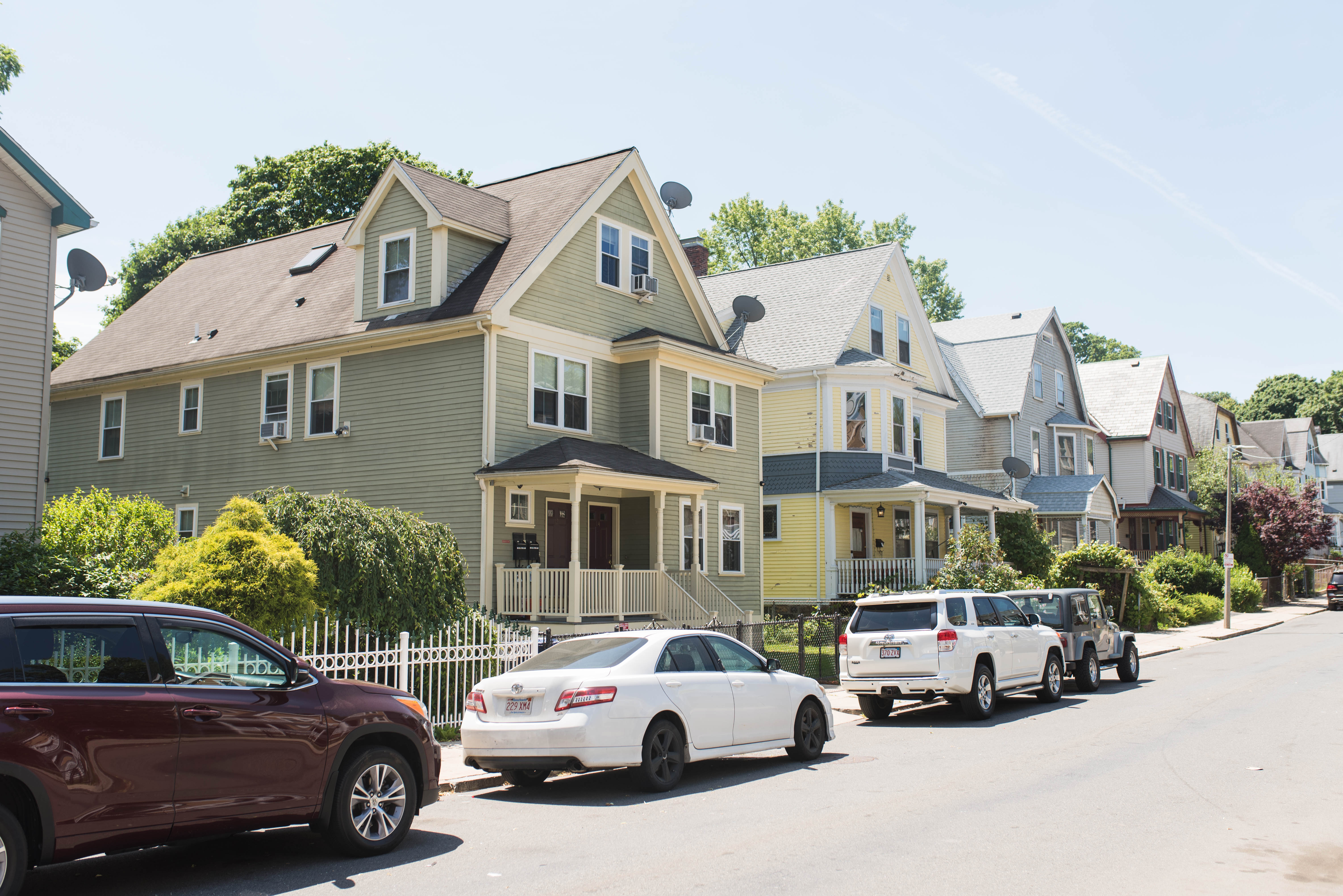 Single-family houses along a sunny street.