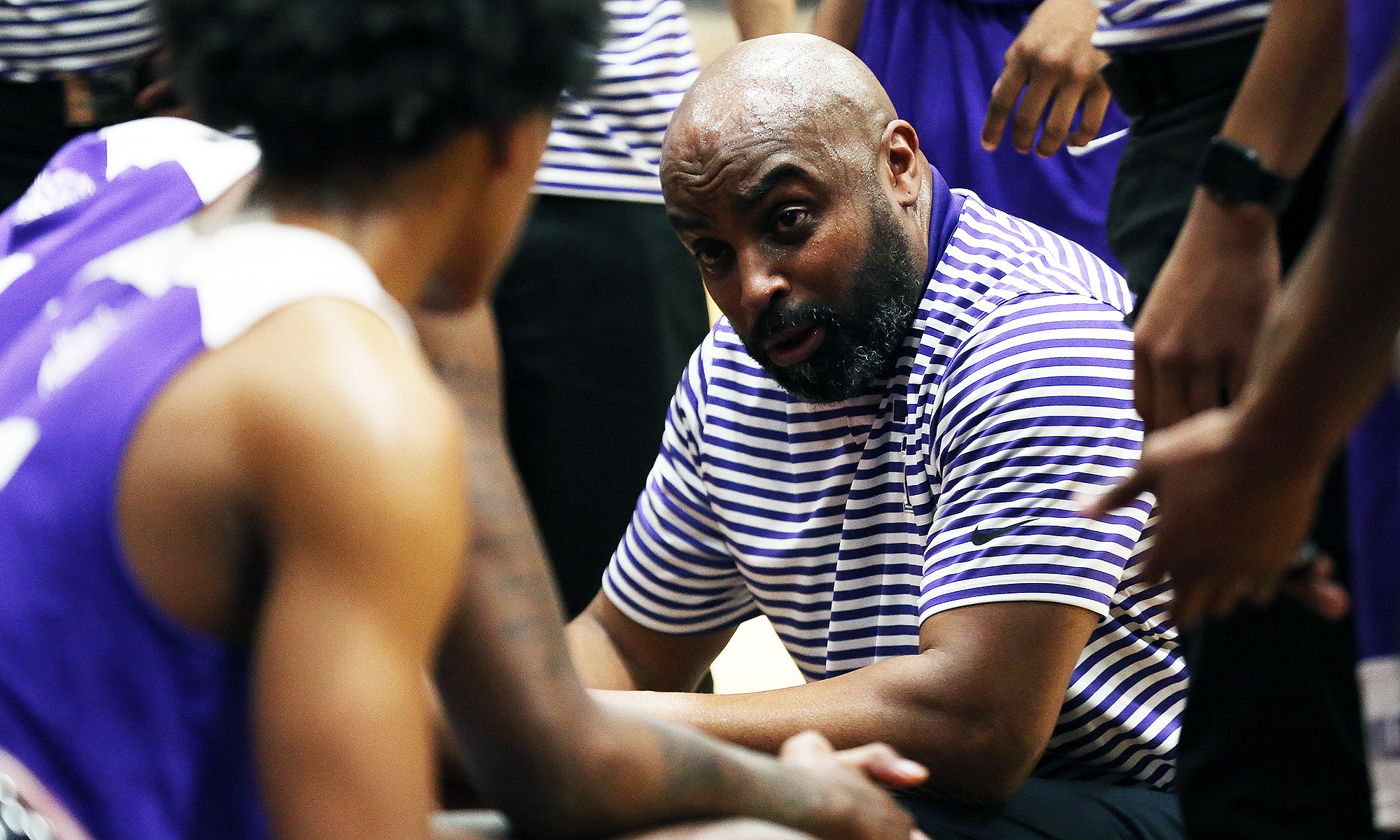 Thornton coach Tai Streets talks to his players as they play Kankakee.