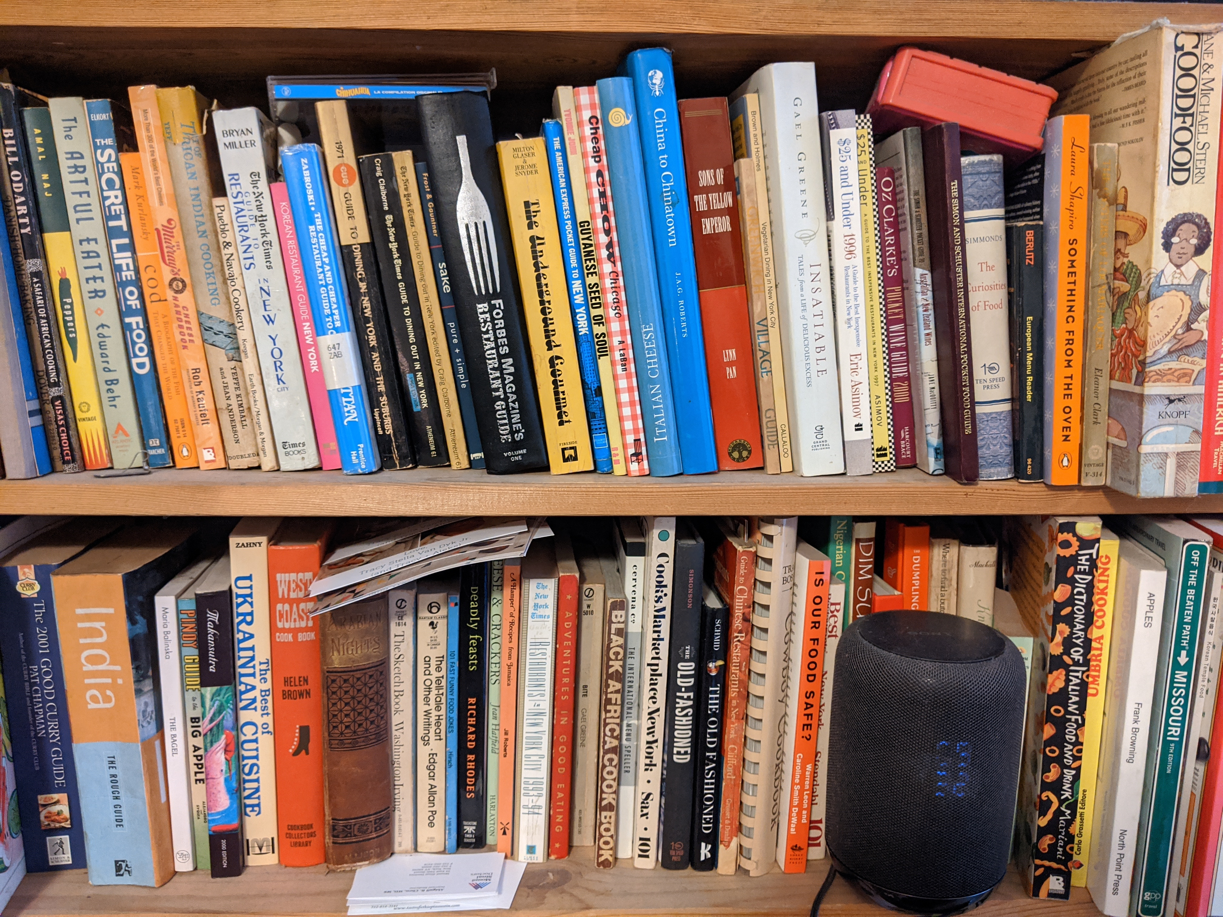 Two bookshelves filled with food books.