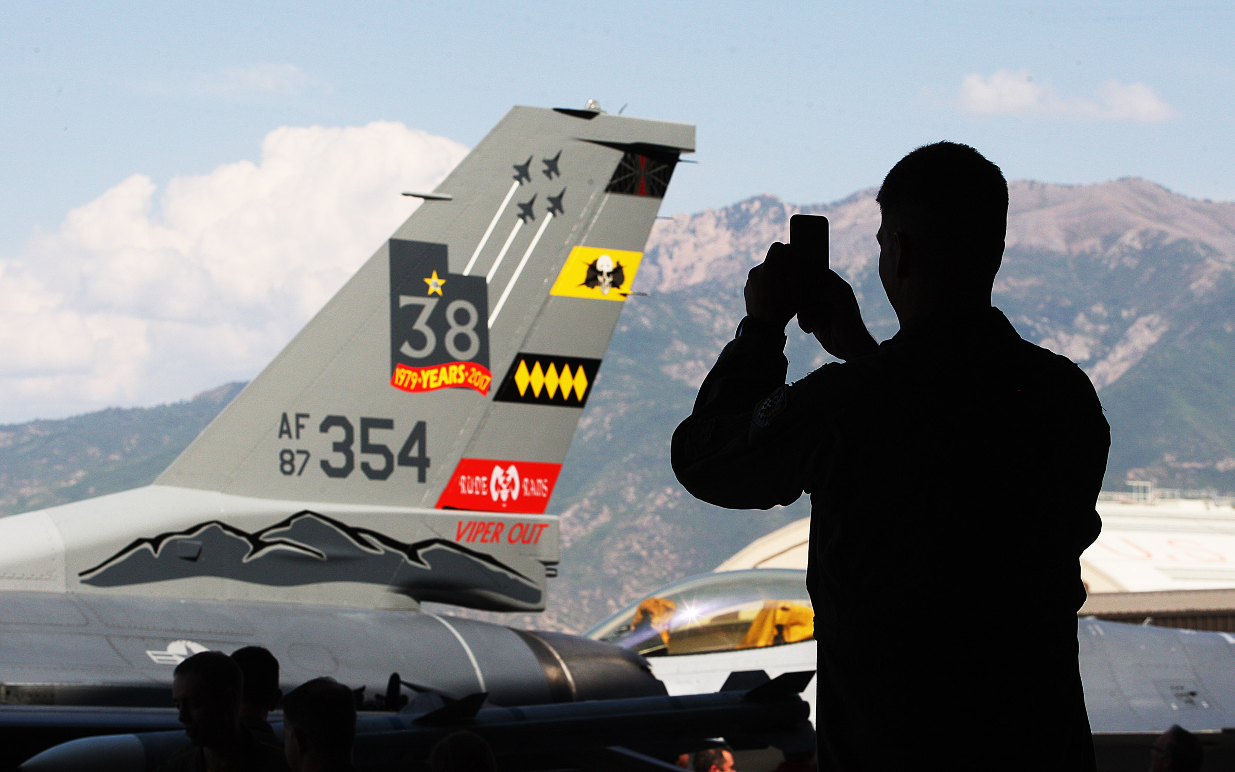 F-16 pilot Maj. Scott Laroche takes a photo of one of the planes as Hill Air Force Base bids farewell to the F-16 at Viper Out ceremony on base. The 388th and 419th fighter wings at Hill AFB bid farewell to the F-16 Fighting Falcon during a ceremony on Friday, Sept. 8, 2017.