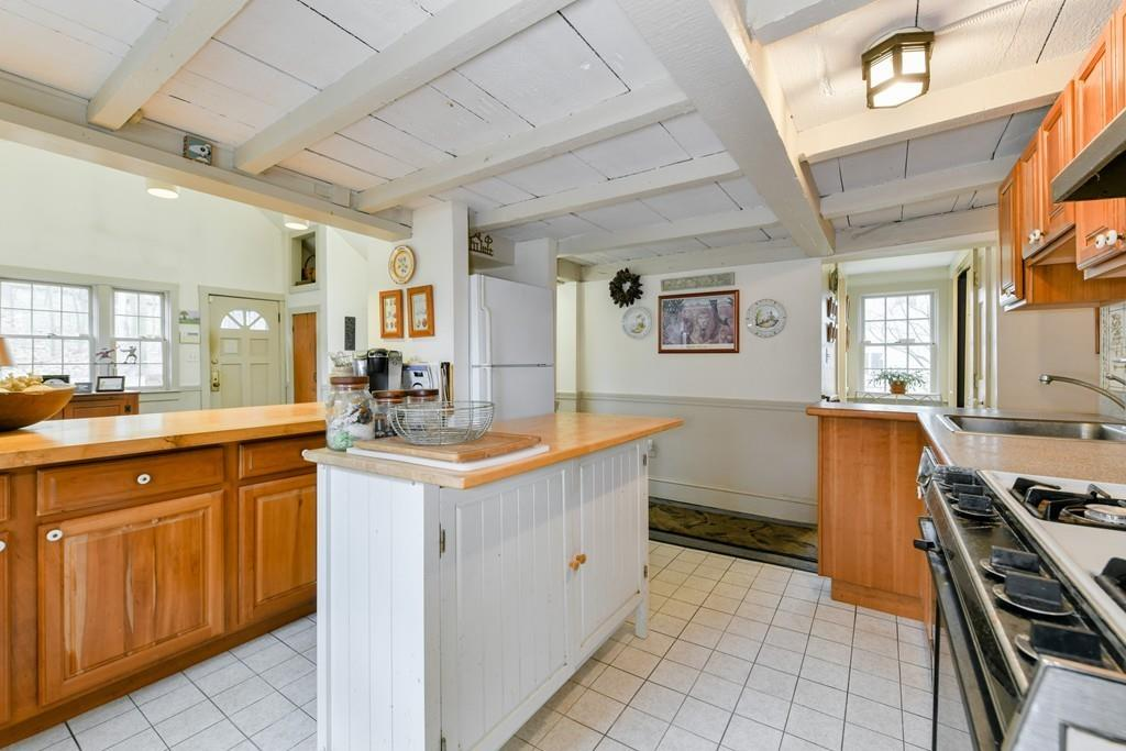 A kitchen with an island.