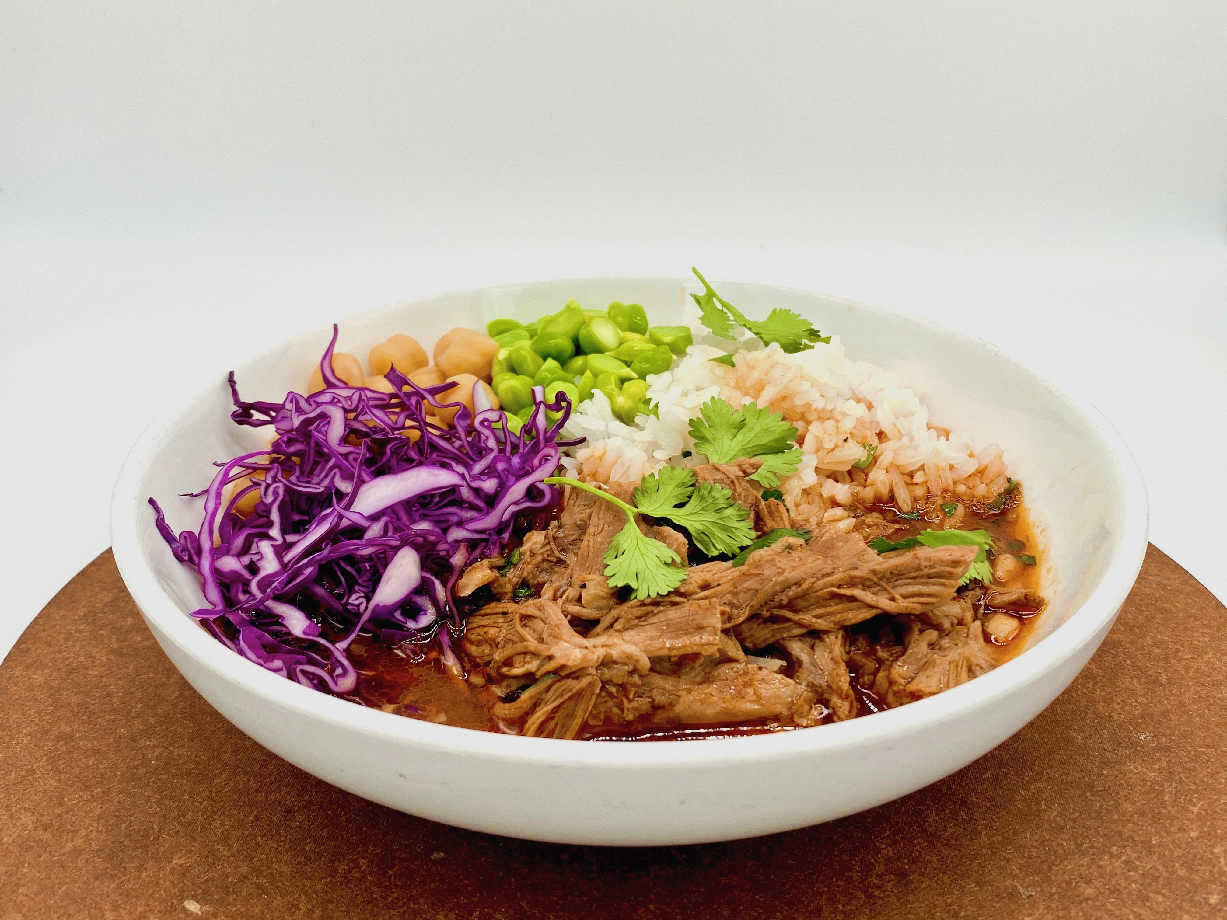 Lamb birria, chickpeas, red cabbage, and white rice