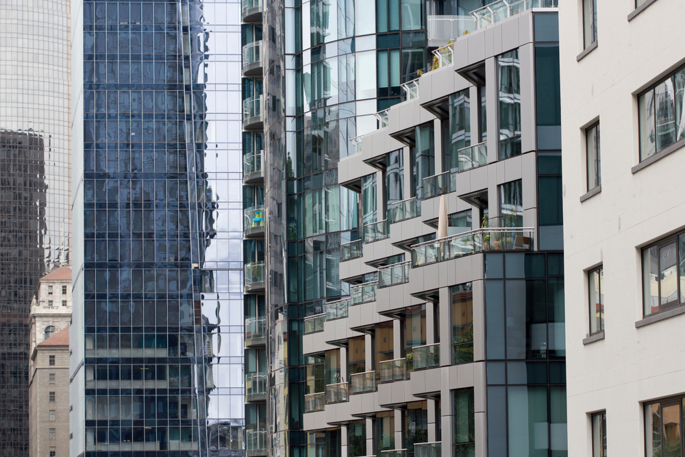 A series of windows on sleek and glassy high-rises.