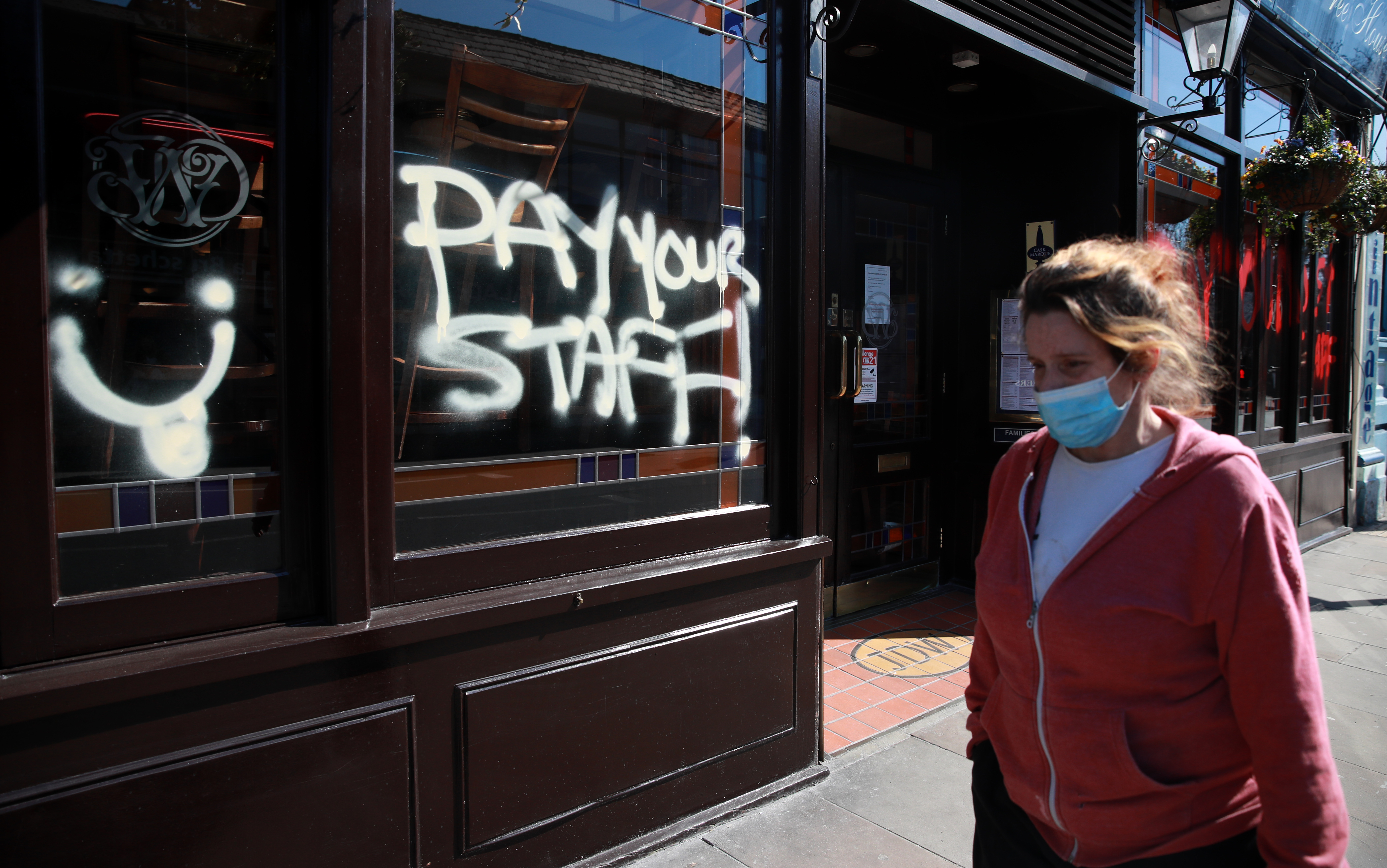 Coronavirus hits Wetherspoons staff: graffiti on a Wetherspoons pub in Crystal Palace