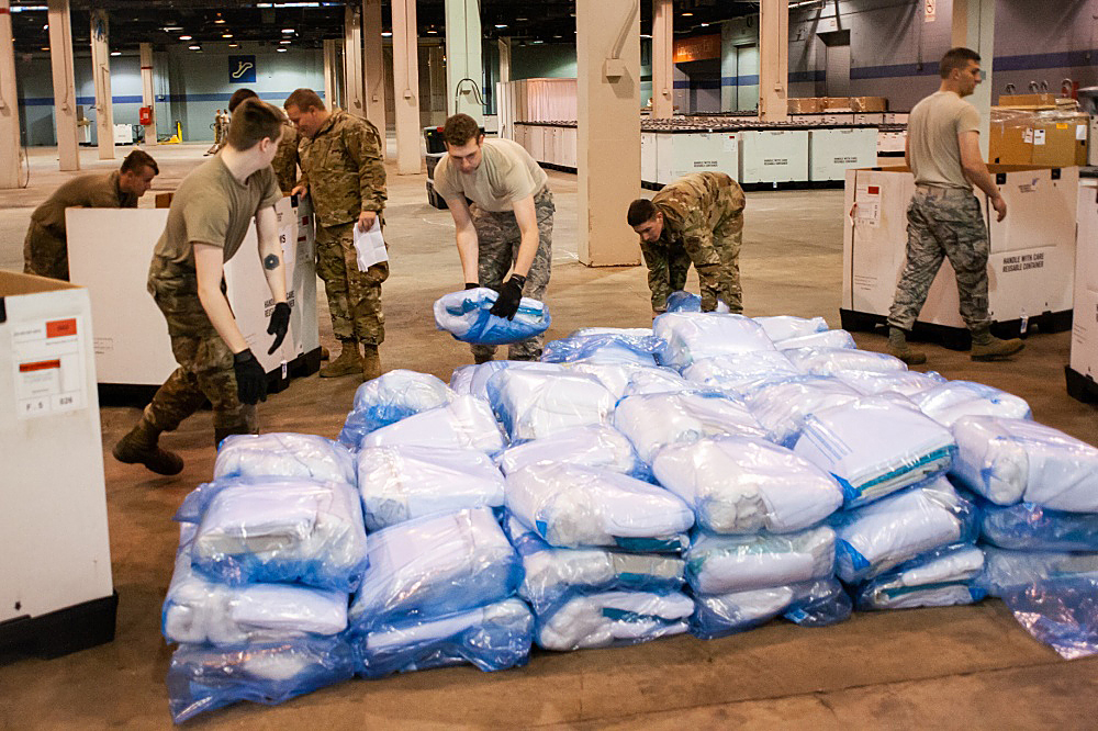 Members of the Illinois Air National Guard assemble medical equipment at McCormick Place.