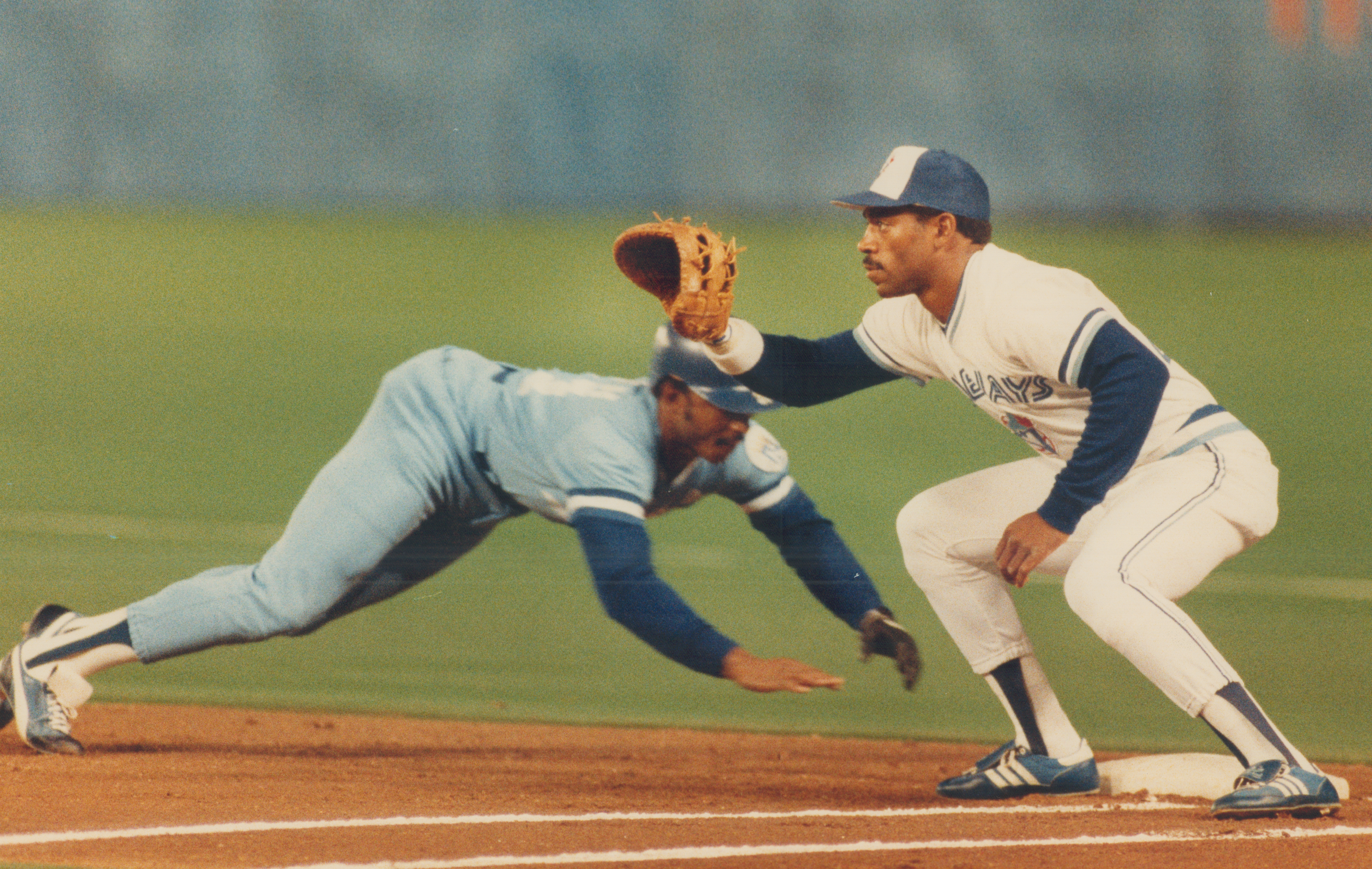 Close enough: Kansas City leftfielder Lonnie Smith does a racing dive to get back to first base on a