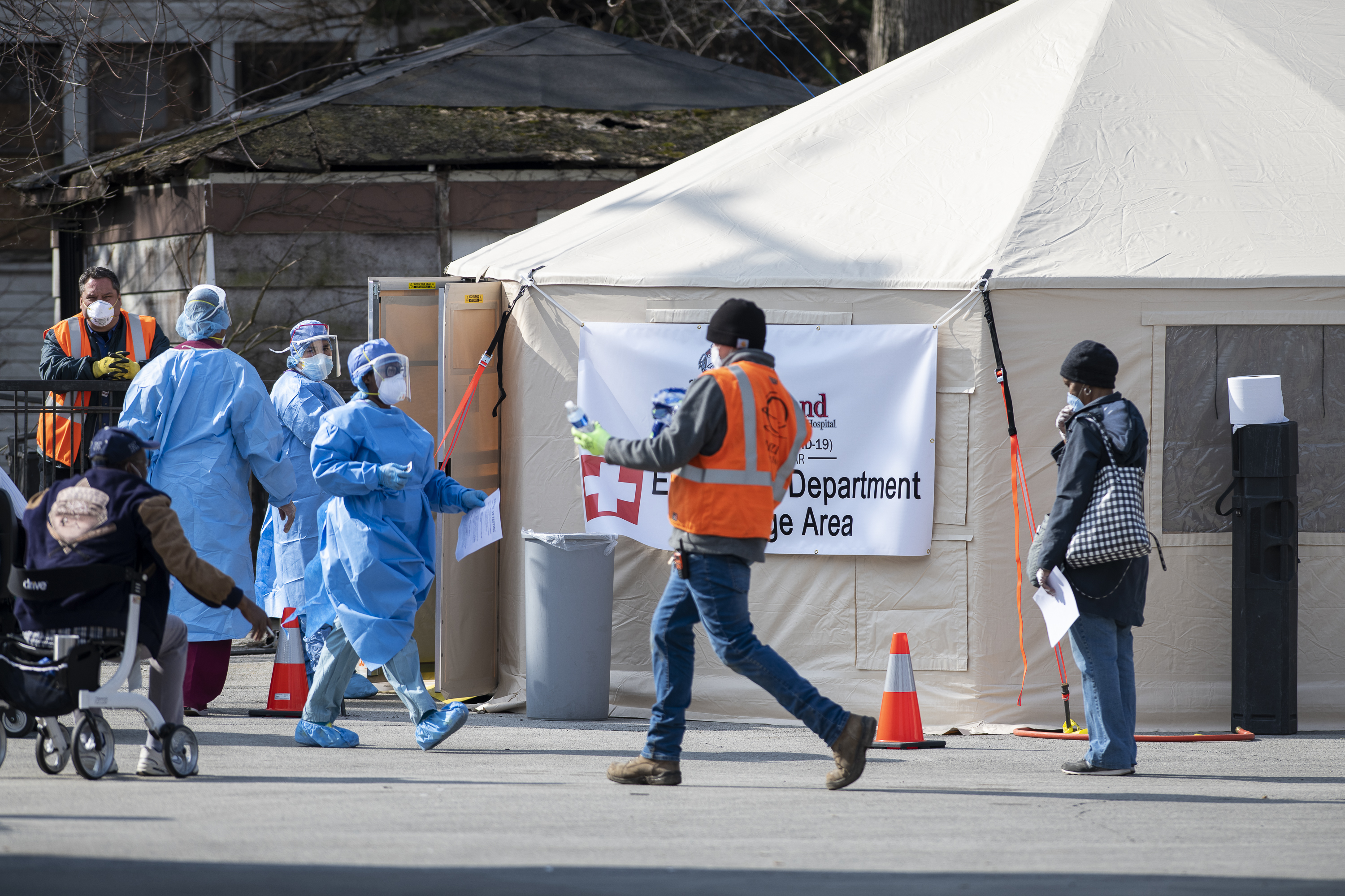 People wait in line to be tested for coronavirus at one of Roseland Community Hospital's testing tents, Friday, April 3, 2020.