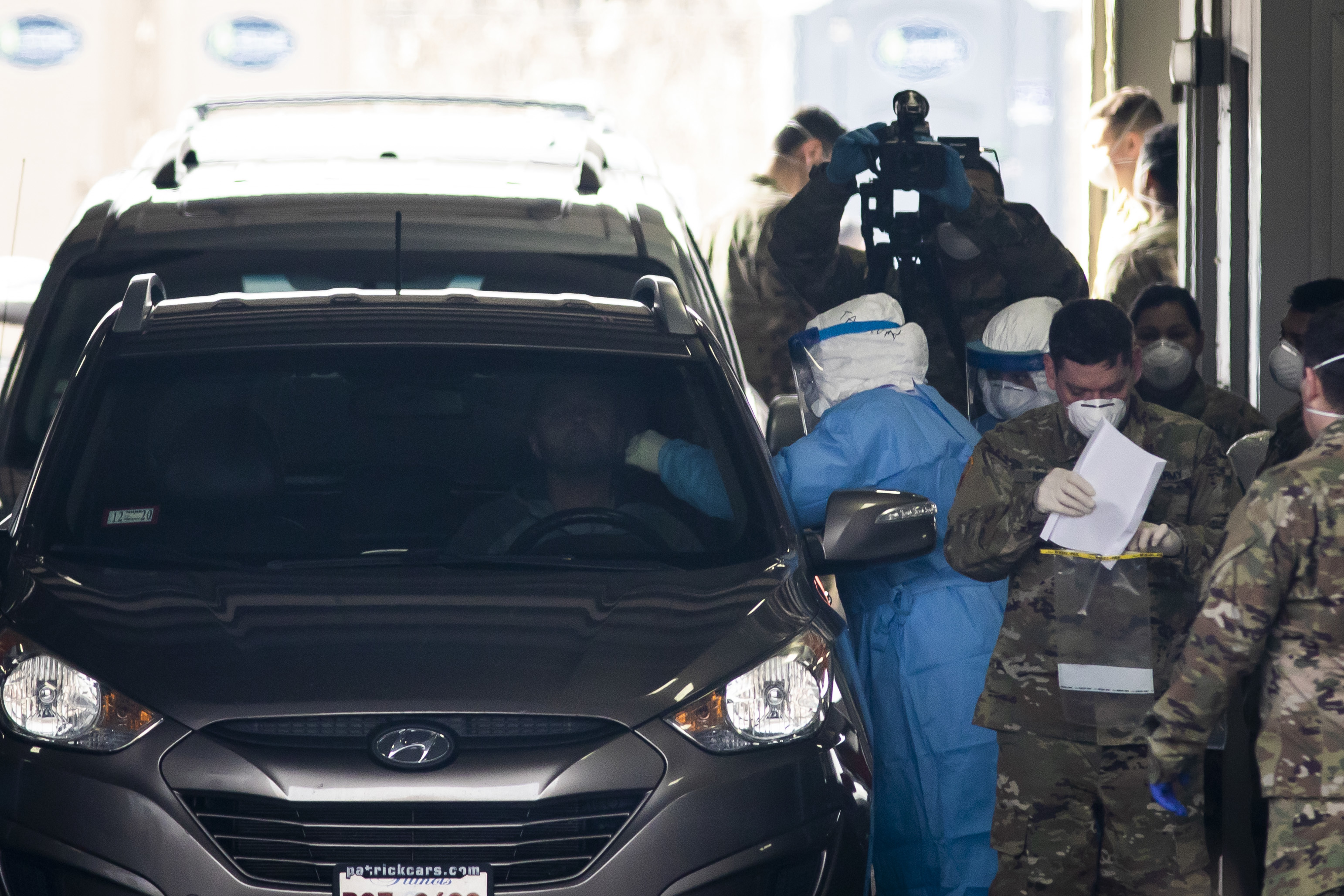 The Illinois National Guard operates a COVID-19 drive-thru test site for medical personnel and first responders at 6959 Forest Preserve Dr., Tuesday morning, March 24, 2020.