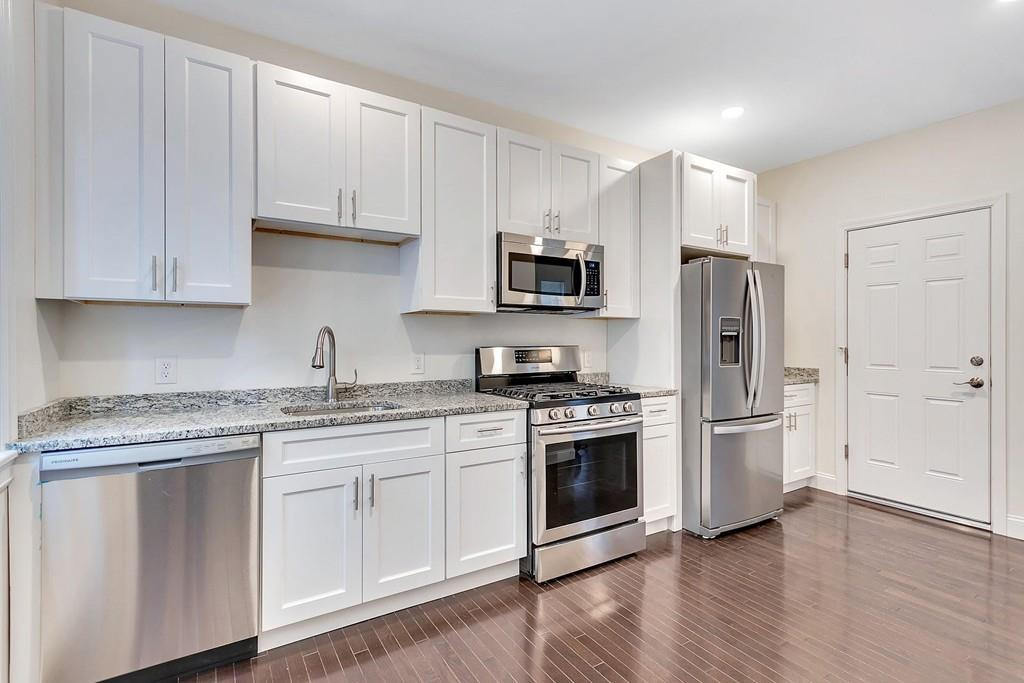 A spacious open kitchen with a long counter.