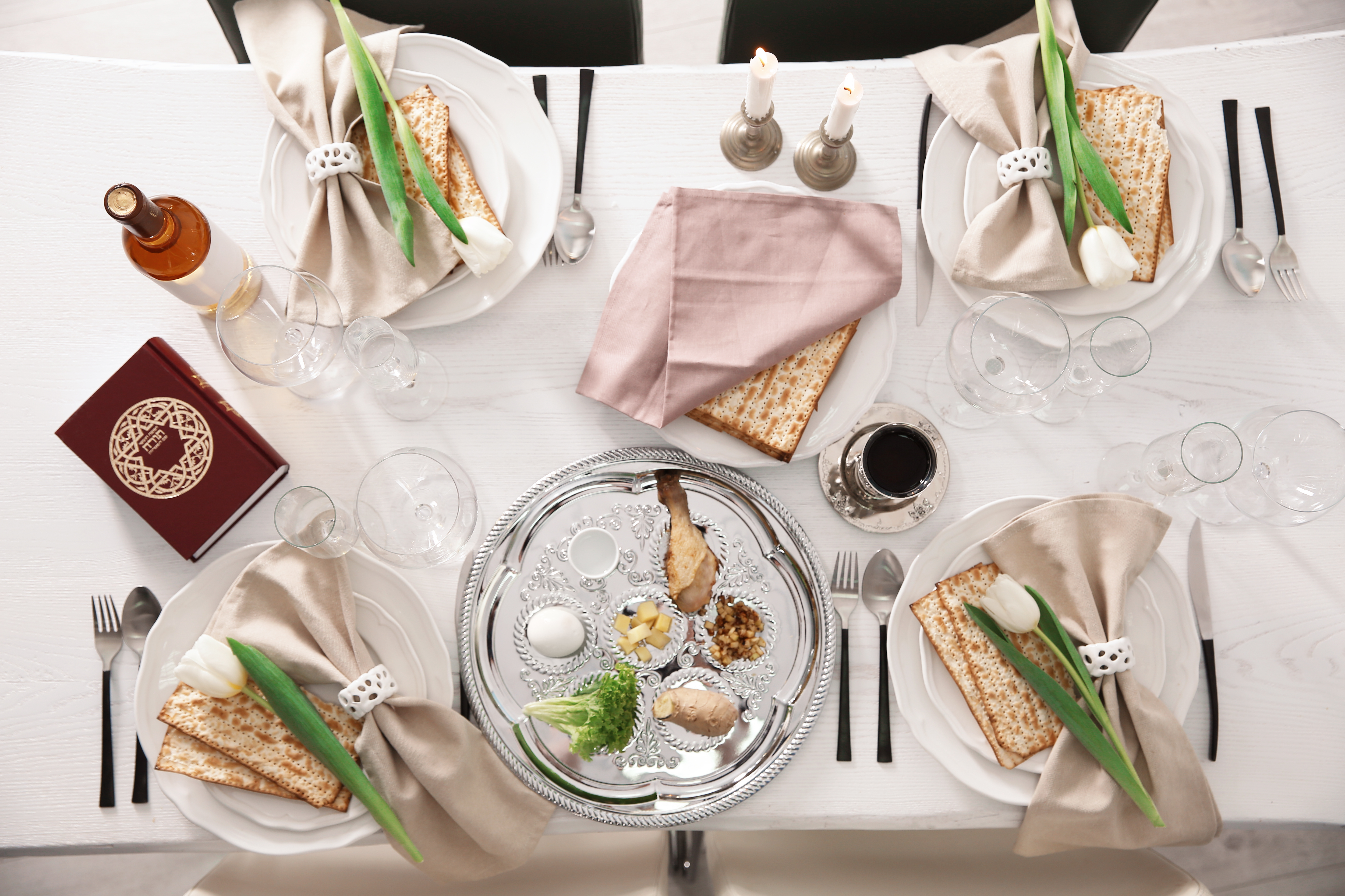 Food and place settings are laid out on a Passover Seder table
