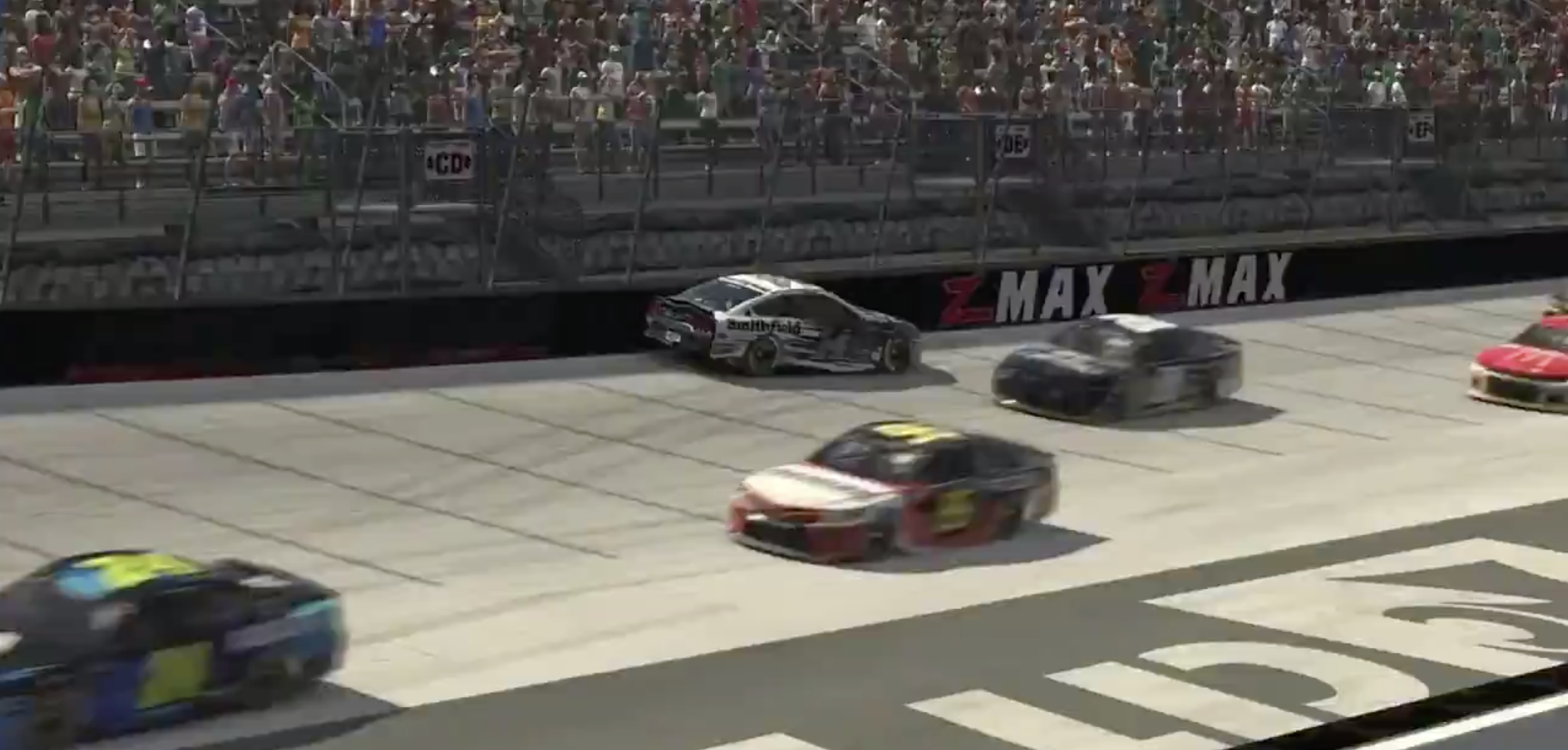 Screenshot of Bubba Wallaces' wrecked car up against the wall and facing backwards on the track during an eNASCAR Pro Invitational series race.