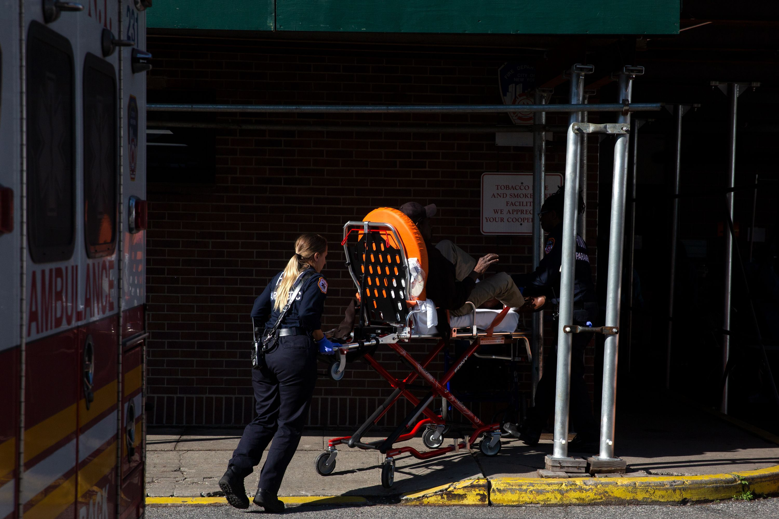 FDNY paramedics bring a patient into the Brooklyn Hospital Center during the coronavirus outbreak.