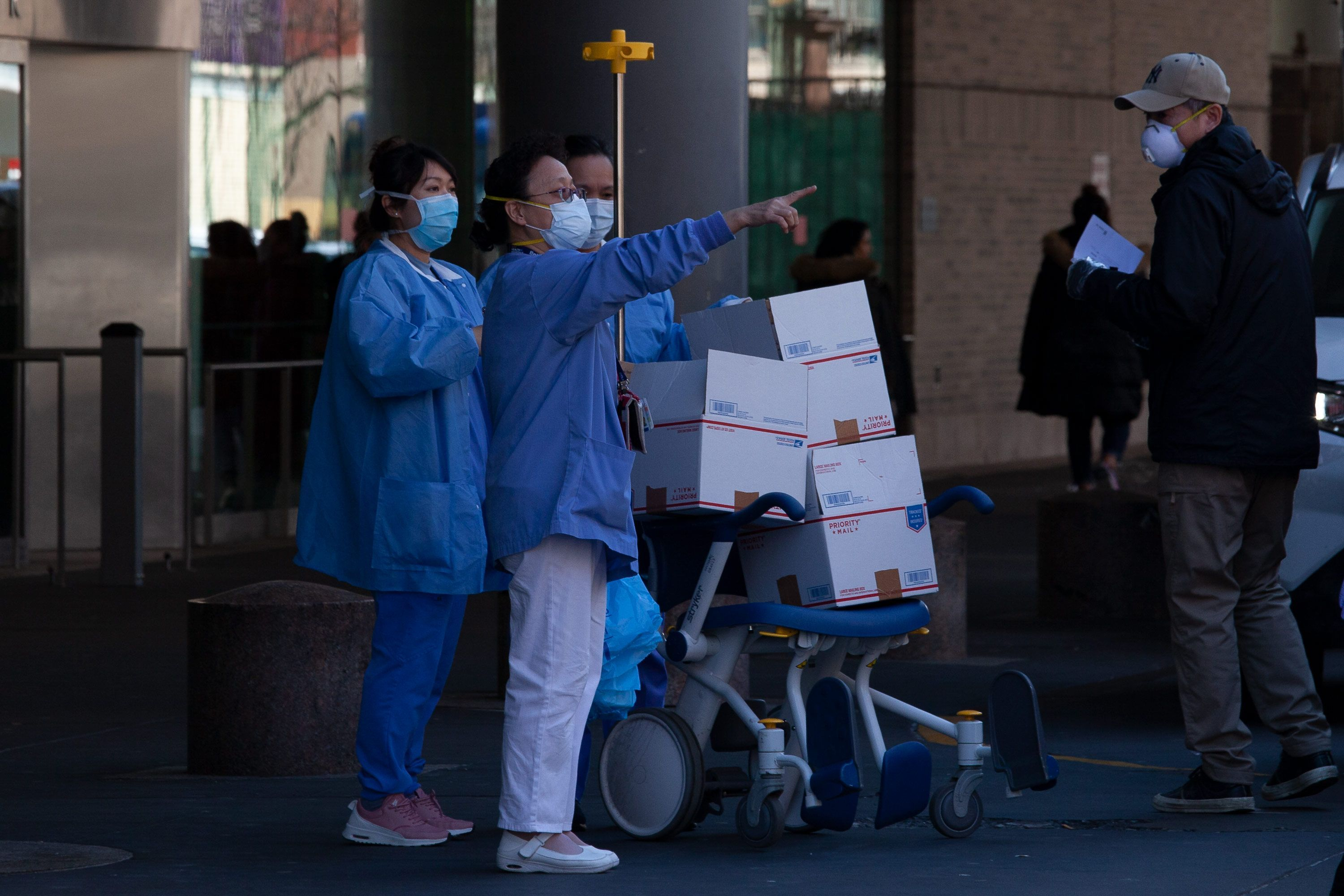 Bellevue Hospital workers accept several packages during the coronavirus outbreak.