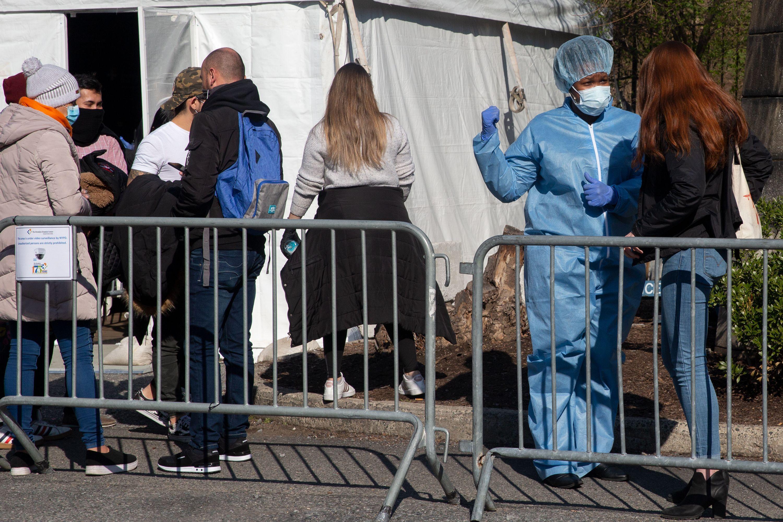 Healthcare workers at Brooklyn Downtown Hospital help pre-screen people coronavirus symptoms.