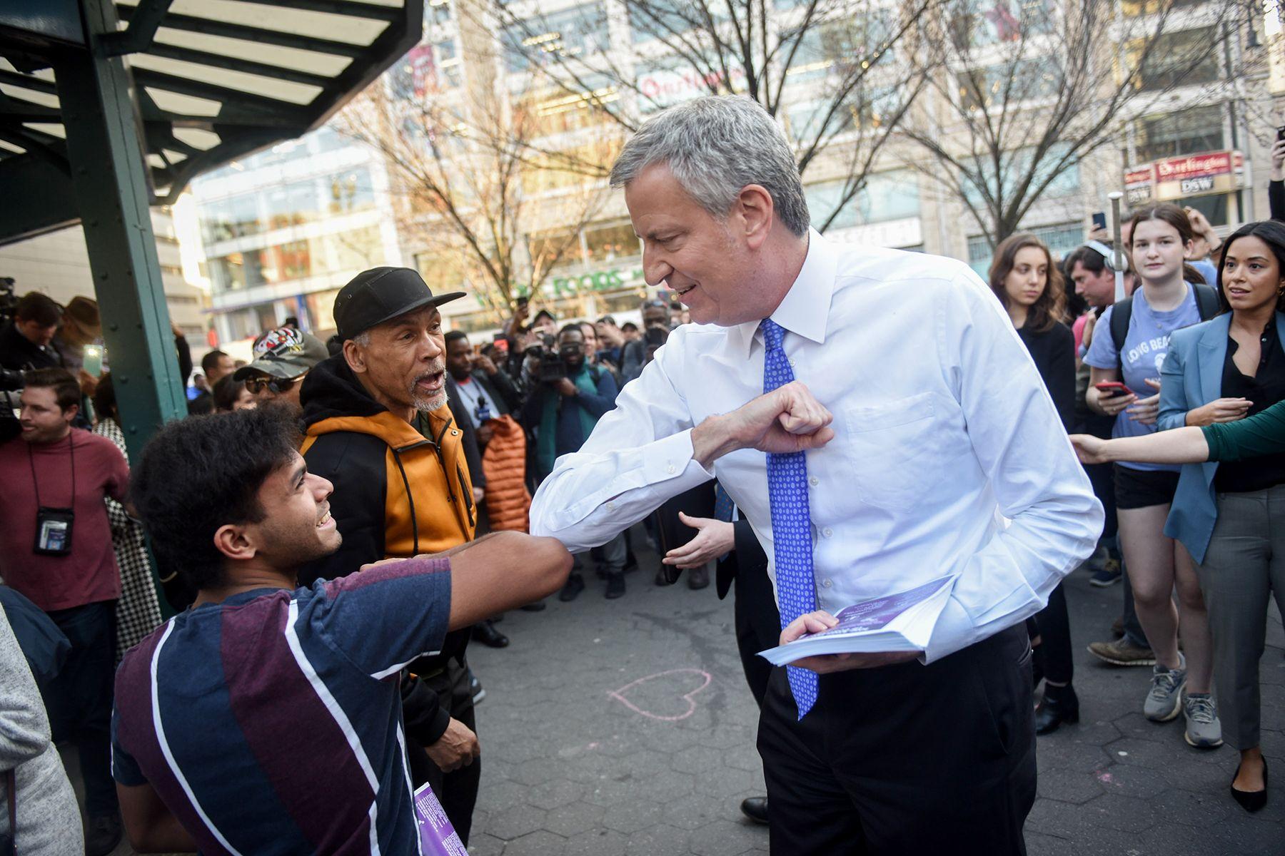 Mayor Bill de Blasio hands out fliers regarding coronavirus preparedness in Union Square on Monday, March 9, 2020.