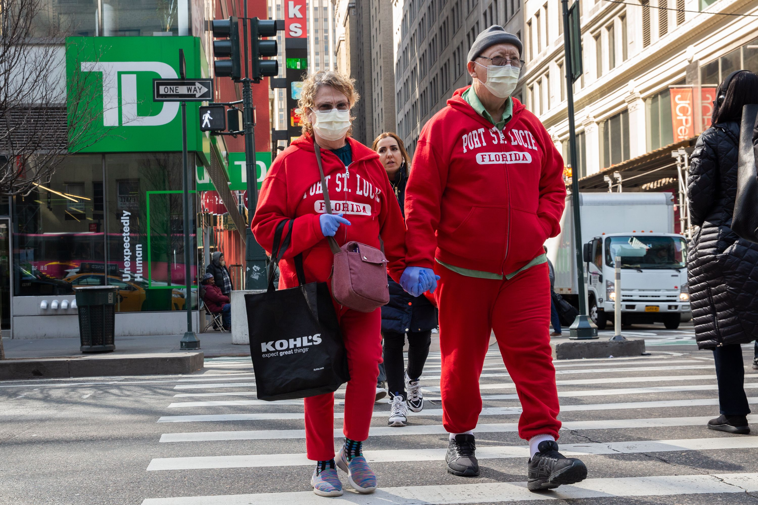 A couple wears masks and gloves while officials found the first case of Coronavirus in the city.