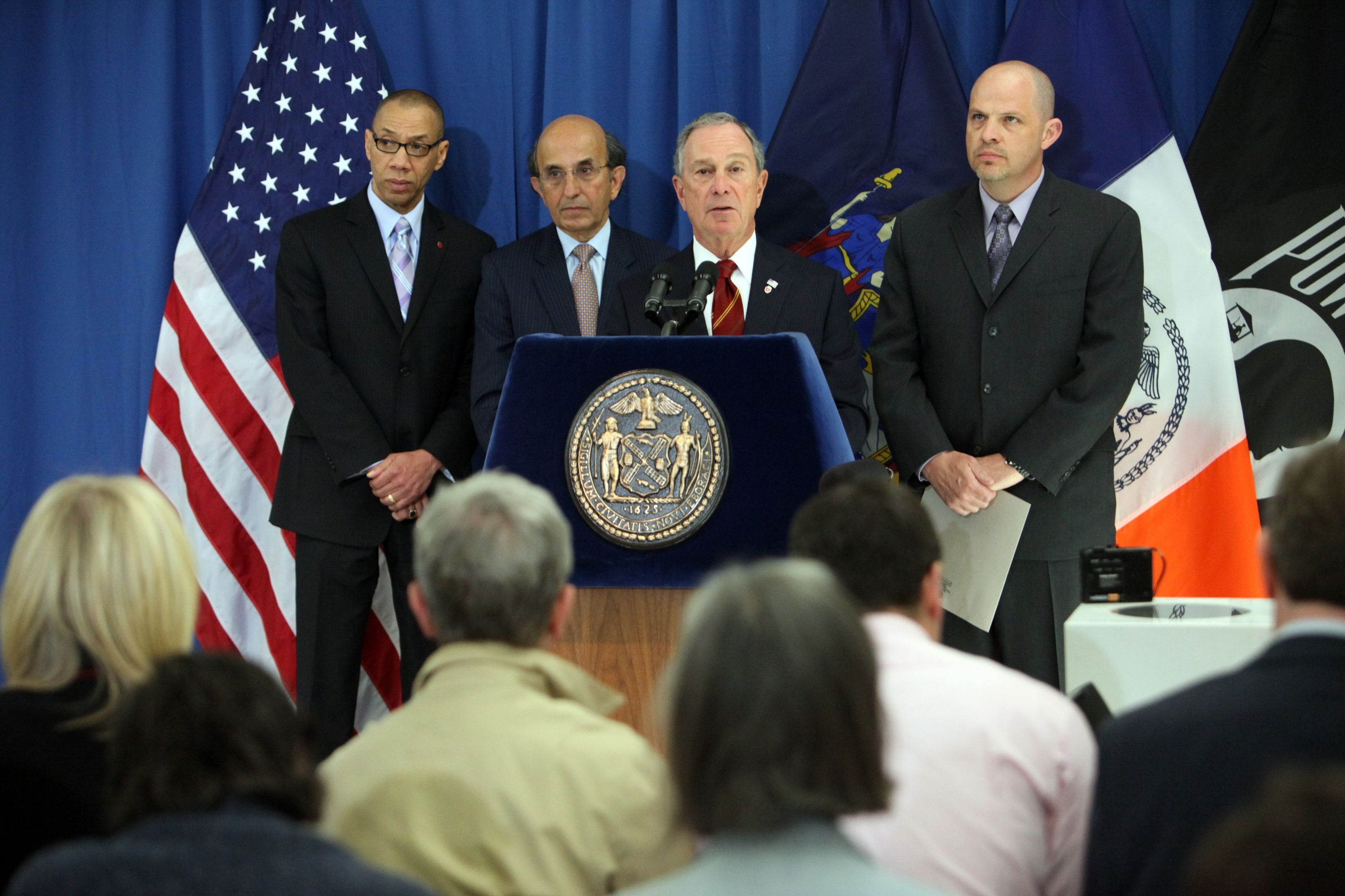 Mayor Michael Bloomberg speaks at a 2010 press conference with United Federation of Teachers President Michael Mulgrew (right), Schools Chancellor Joel Klein (left), and Deputy Mayor for Education Dennis Walcott (far left).