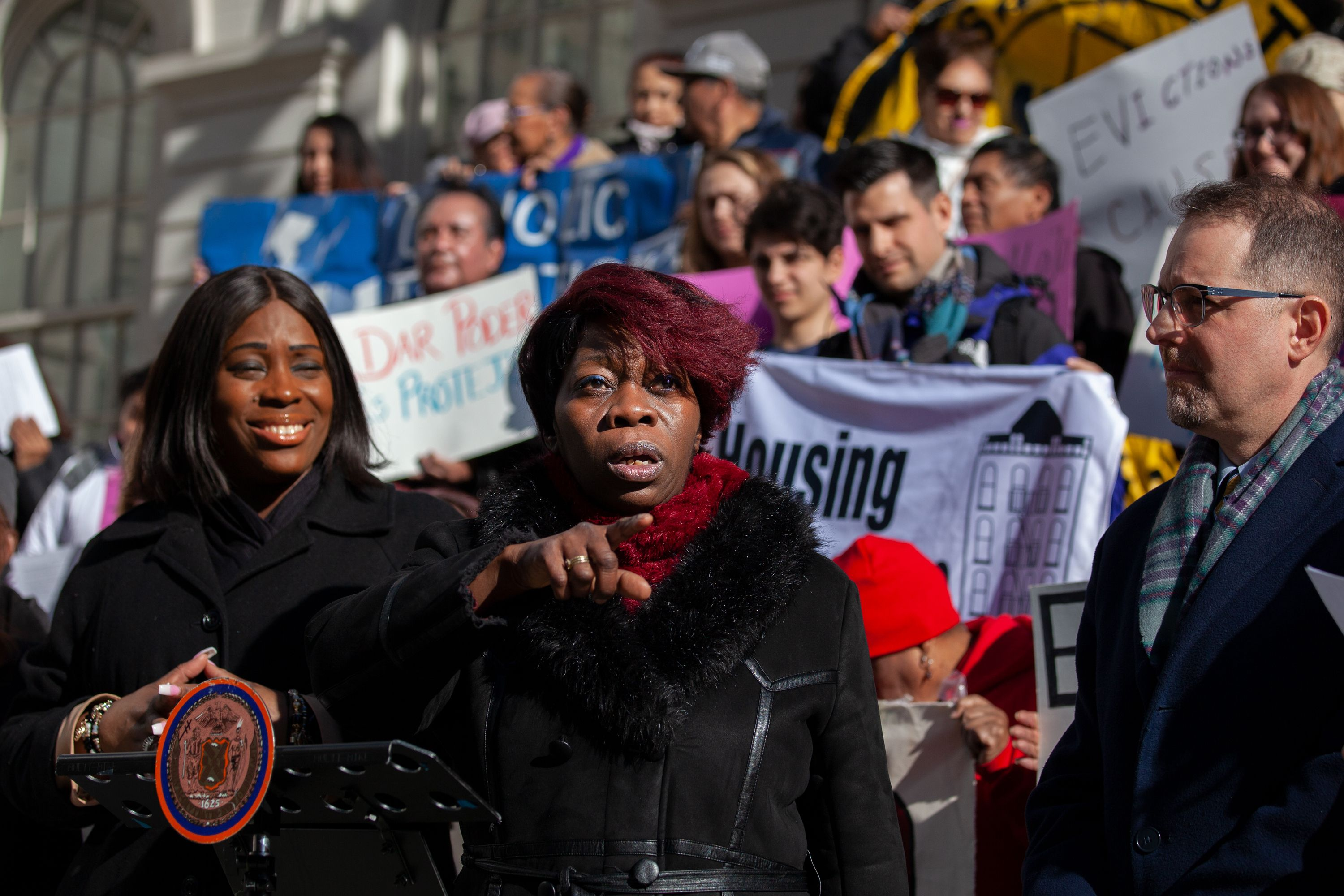 Tenant rights organizer Sandra Mitchell speaks at a City Hall rally before a vote on the Right to Counsel bill.