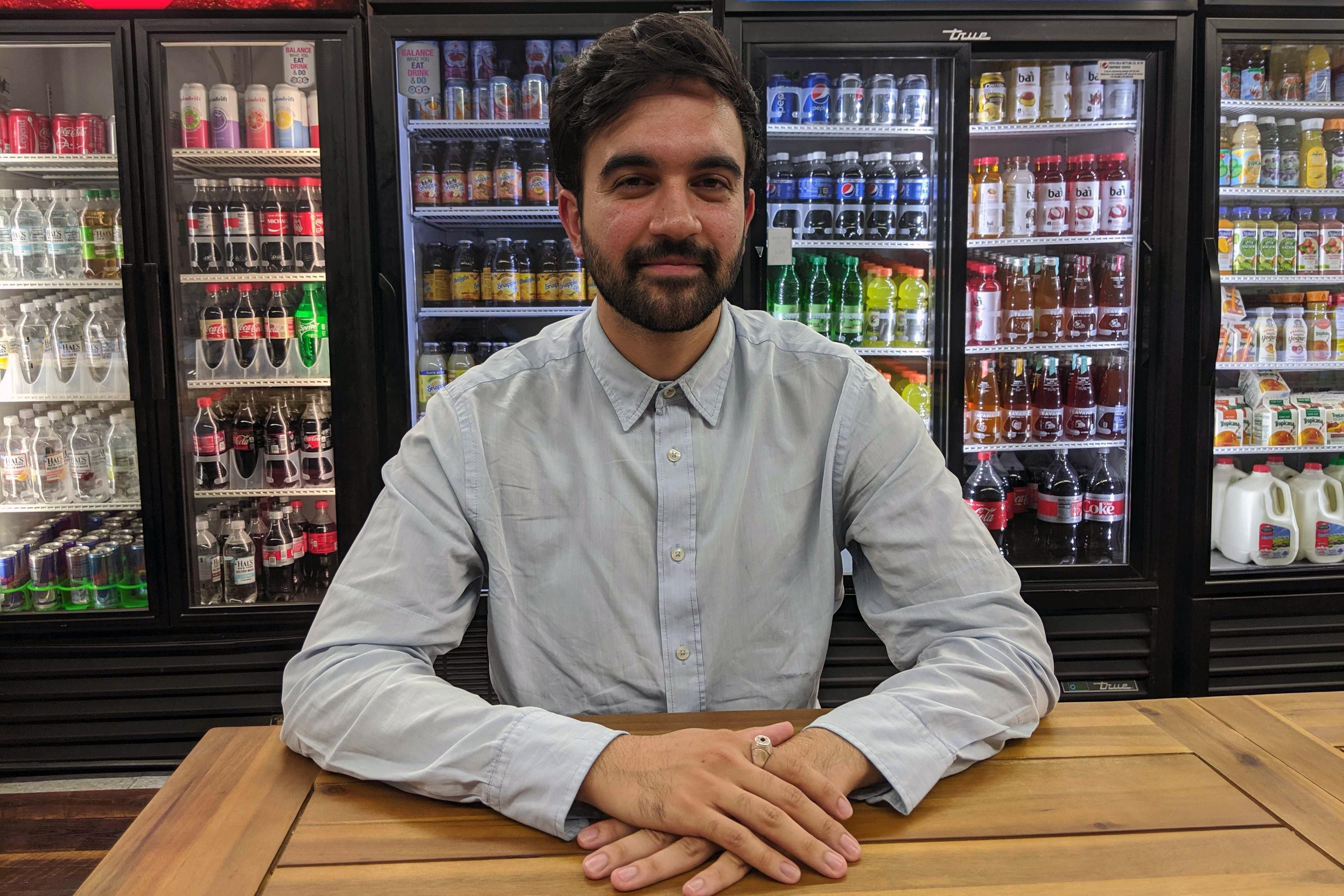 Zohran Mamdani talks to THE CITY in a Jackson Heights deli.