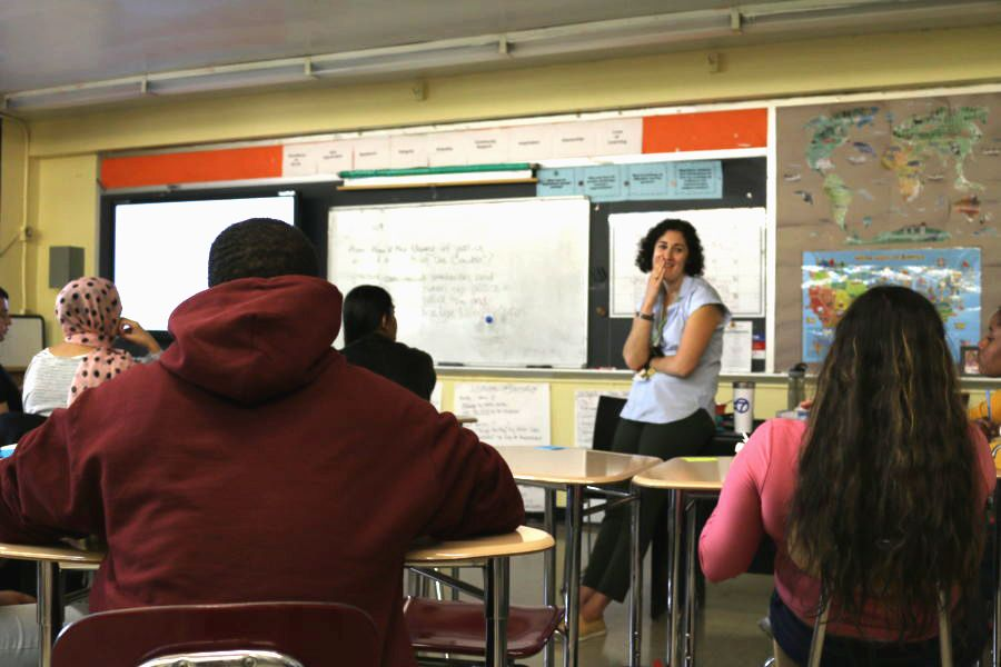 """An English teacher chats about """"The Crucible"""" with her class at ELLIS Prep Academy in the Bronx, a transfer school that serves immigrant students."""