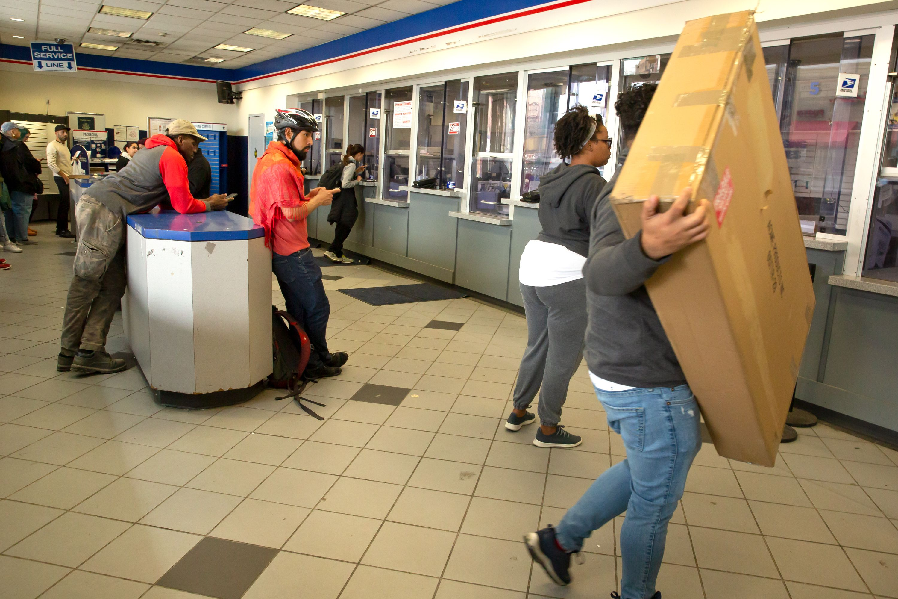 Customers wait inside Bushwick's main post office at Broadway and Gates Avenue, March 15, 2019. The site has been flagged for substandard service by a federal audit.