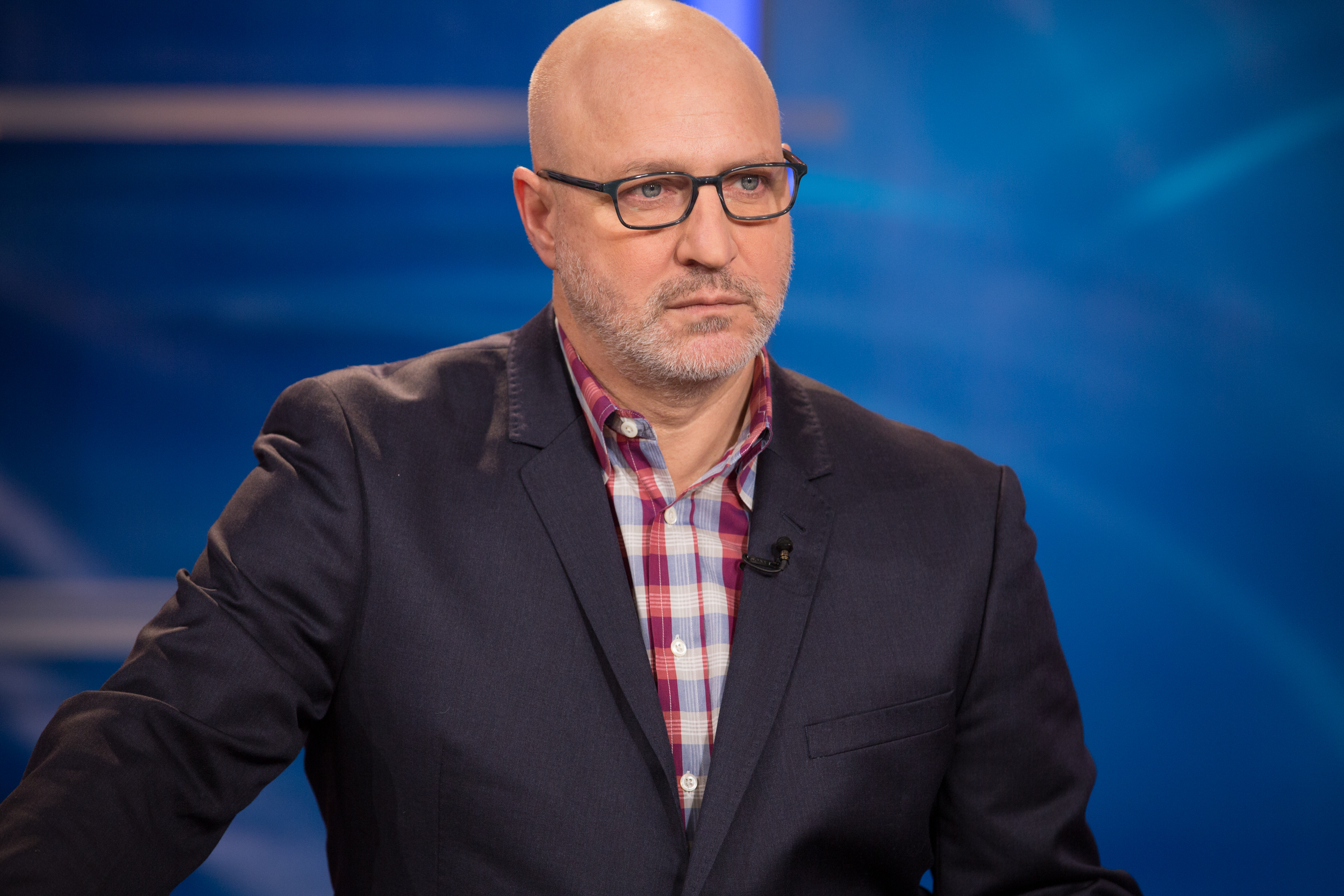 Tom Colicchio standing with glasses on.