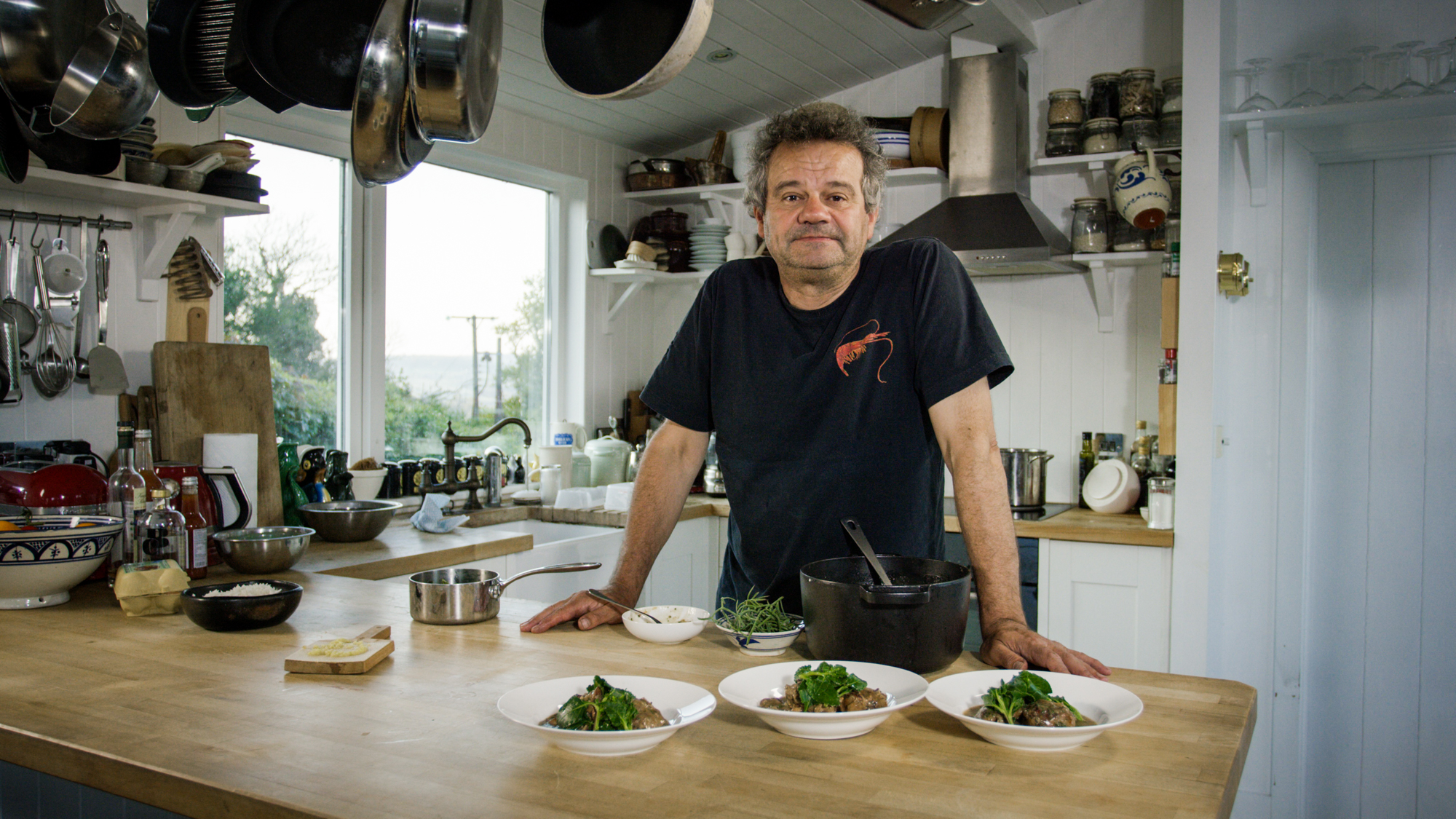 Chef Mark Hix stands in his kitchen, as his London restaurants go into administration