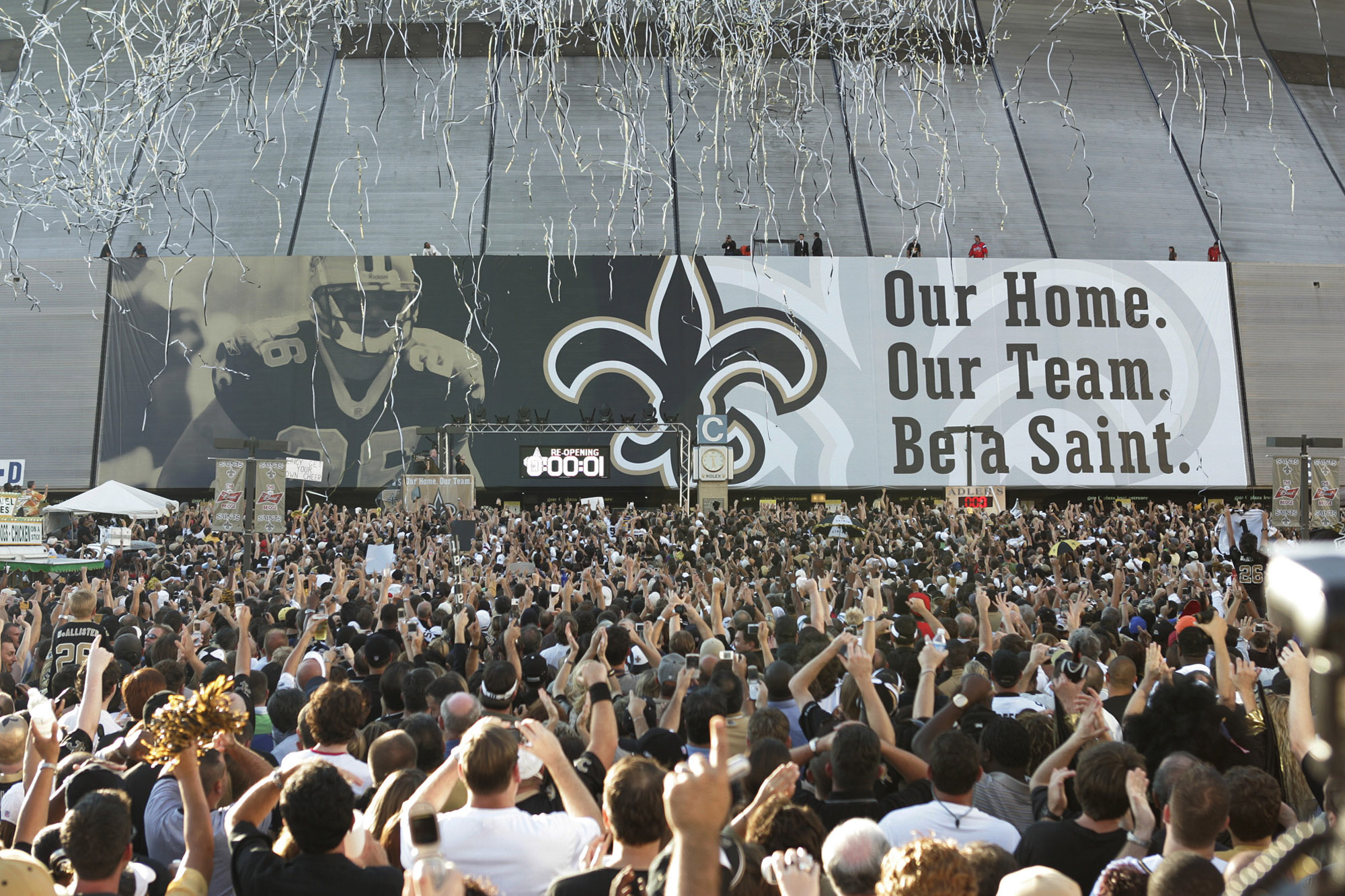 New Orleans Saints' fans celebrate as the banner drops for t