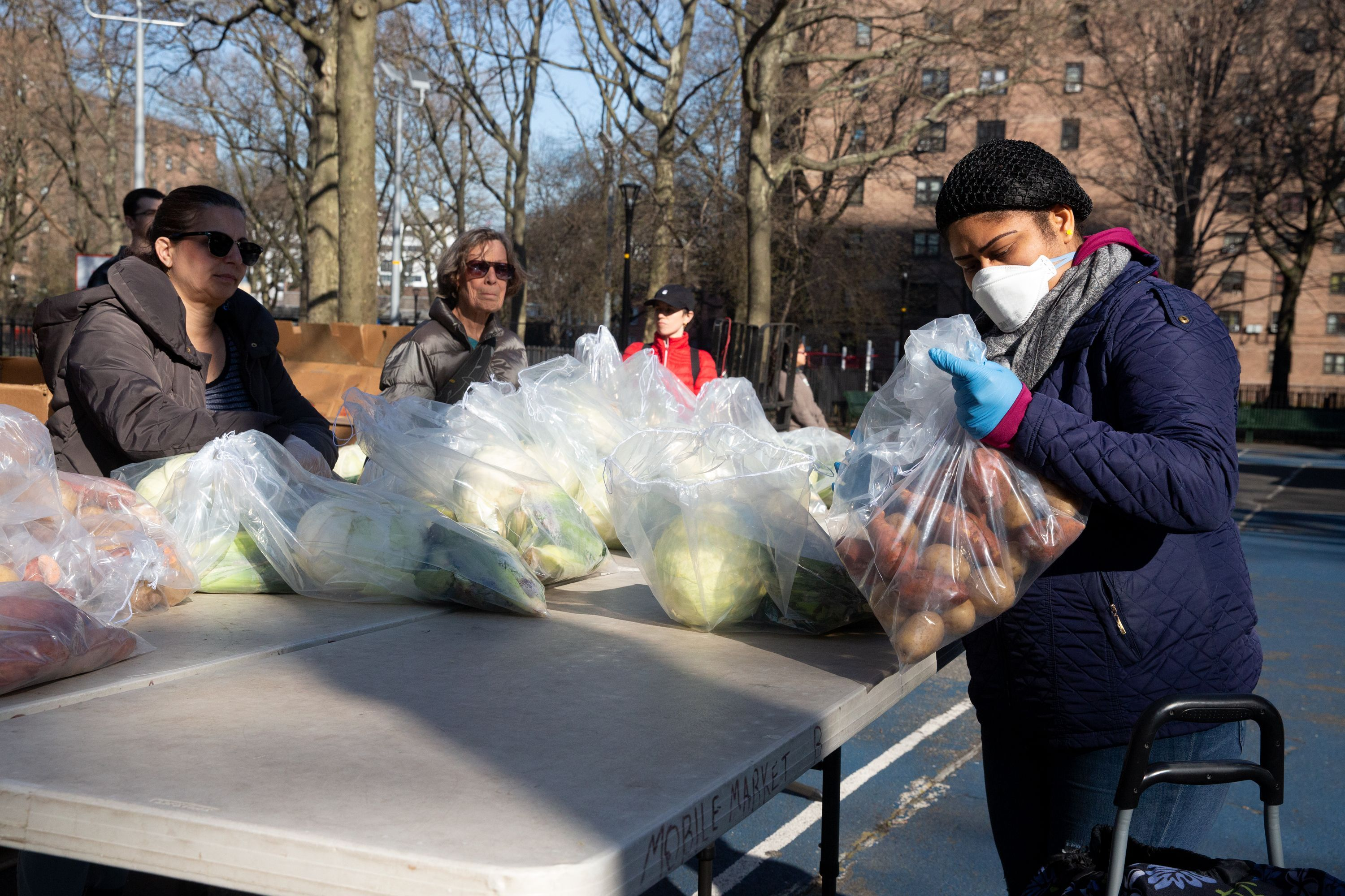 The nonprofit City Harvest set up a food bank at the Tompkins Houses in Bed-Stuy, Brooklyn.