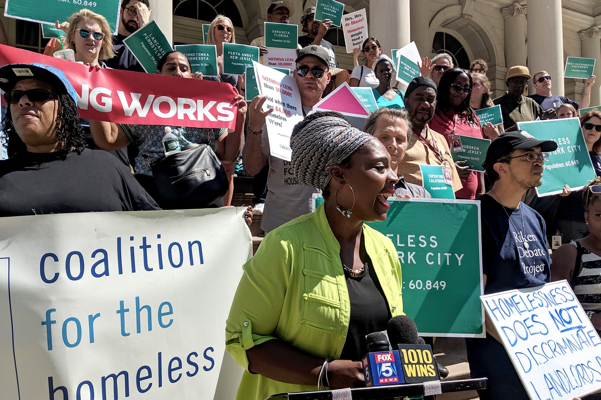 Homeless advocate Came'e Lee and her son are searching for permanent housing after being legally evicted from their Queens home. She spoke at a rally in front of City Hall on Aug. 20, 2019.