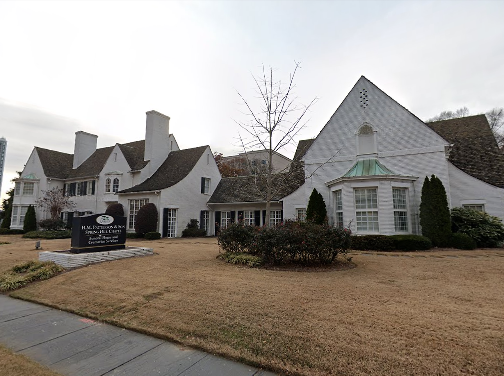 A white neo-classical manor in Midtown Atlanta.