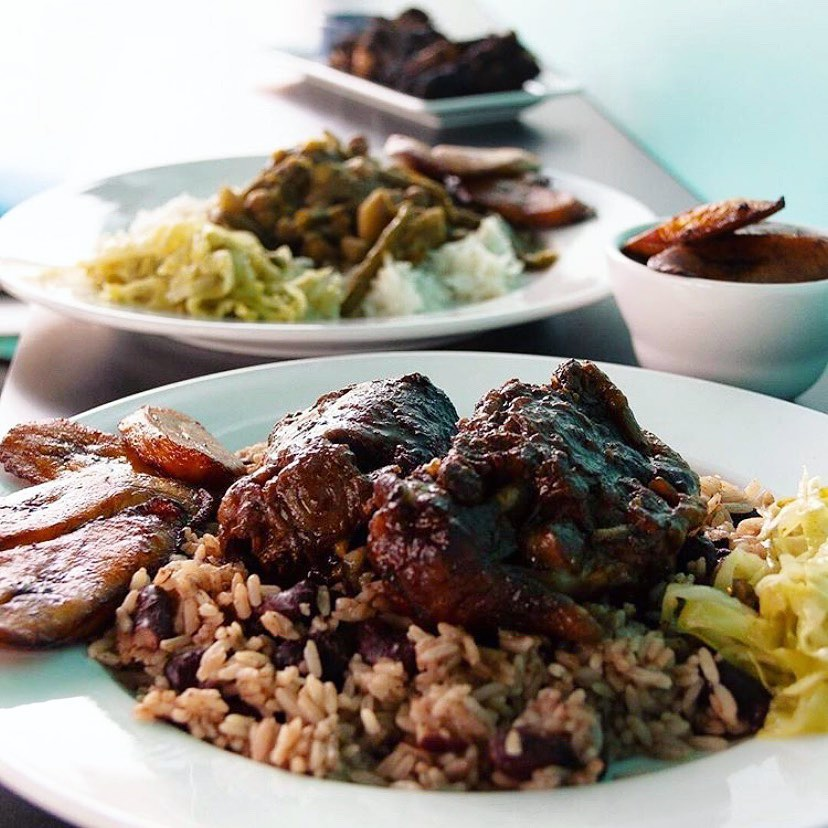 Plates of grilled meat on rice and beans.