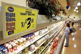 A shopper checks out dairy foods at a Kroger in Cincinnati. Kroger's first-quarter profit rose 4 percent.