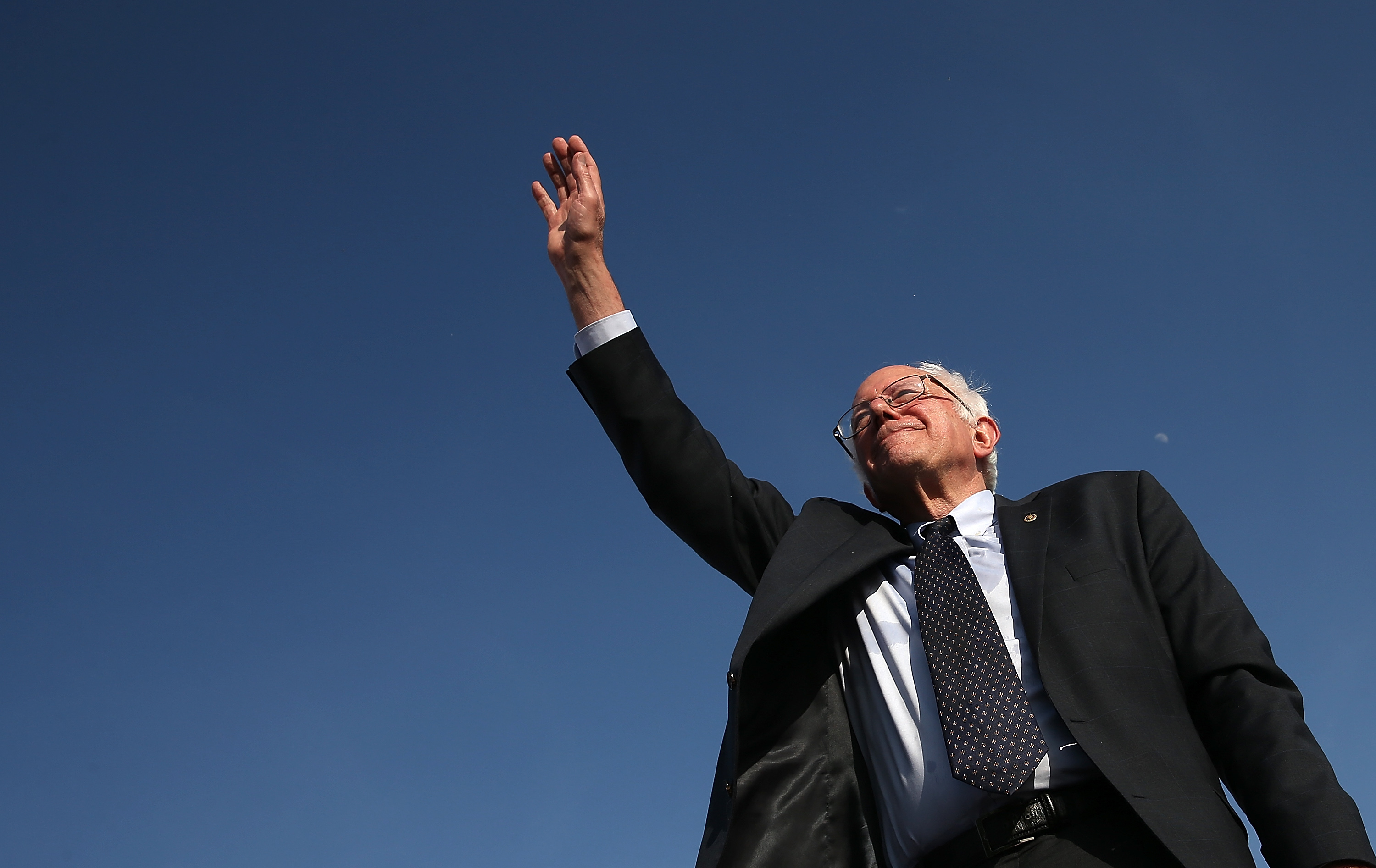 Bernie Sanders waves.