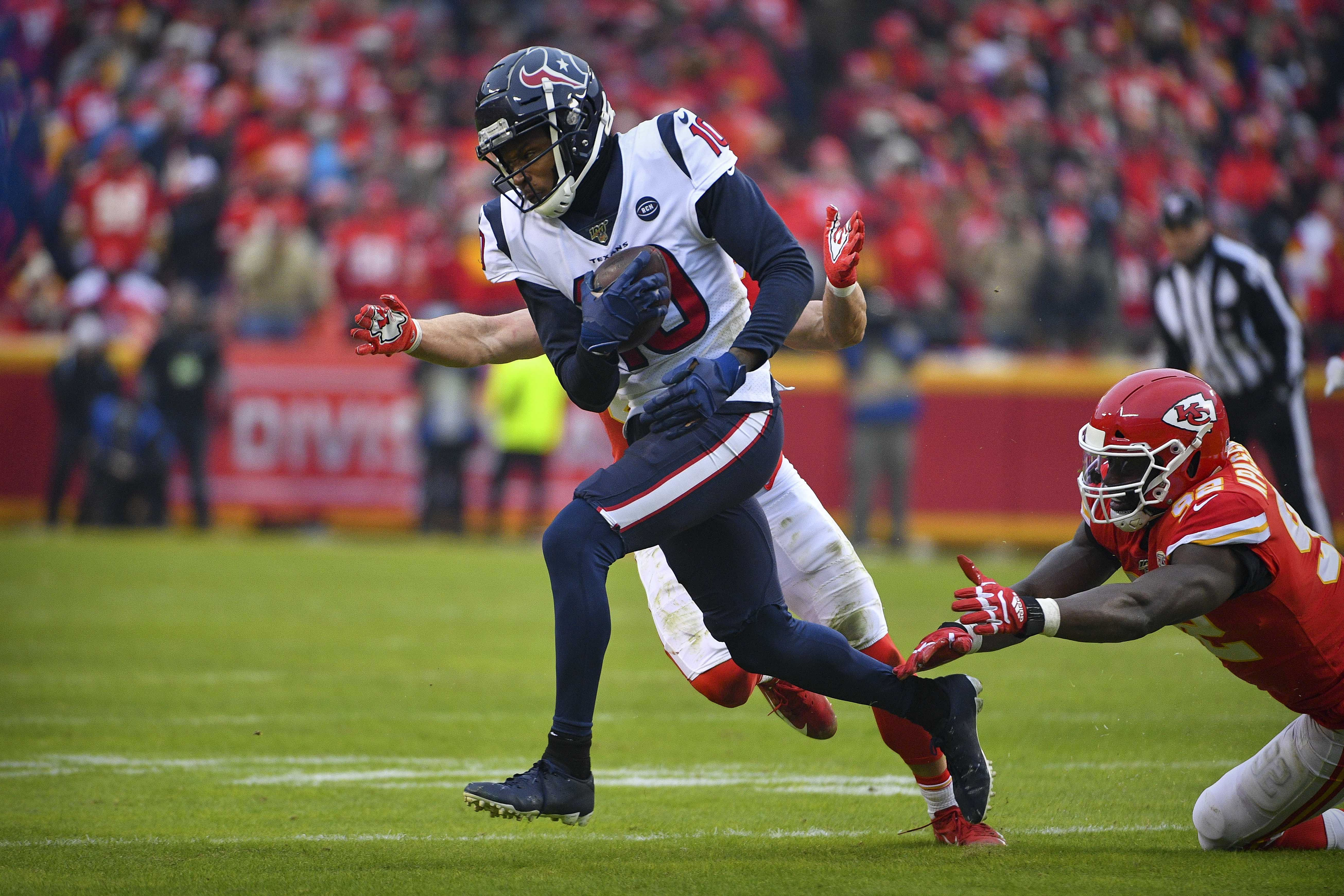 Houston Texans wide receiver DeAndre Hopkins runs against the Kansas City Chiefs during the second quarter in a AFC Divisional Round playoff football game at Arrowhead Stadium.