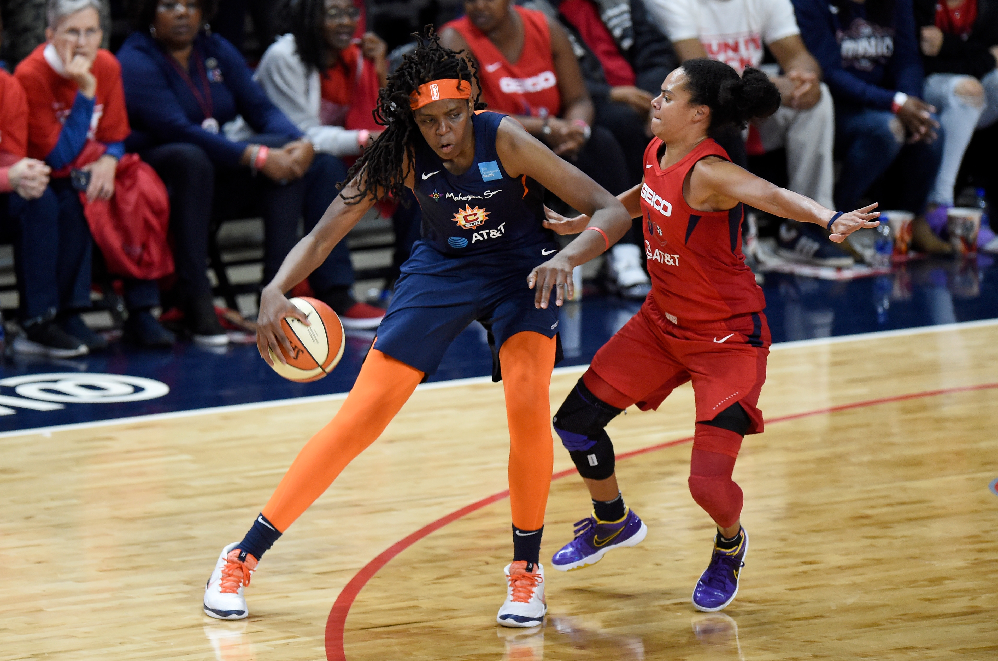 Jonquel Jones of the Connecticut Sun handles the ball against Kristi Toliver of the Washington Mystics in Game 5 of the 2019 WNBA Finals at St Elizabeths East Entertainment & Sports Arena on October 10, 2019 in Washington, DC.