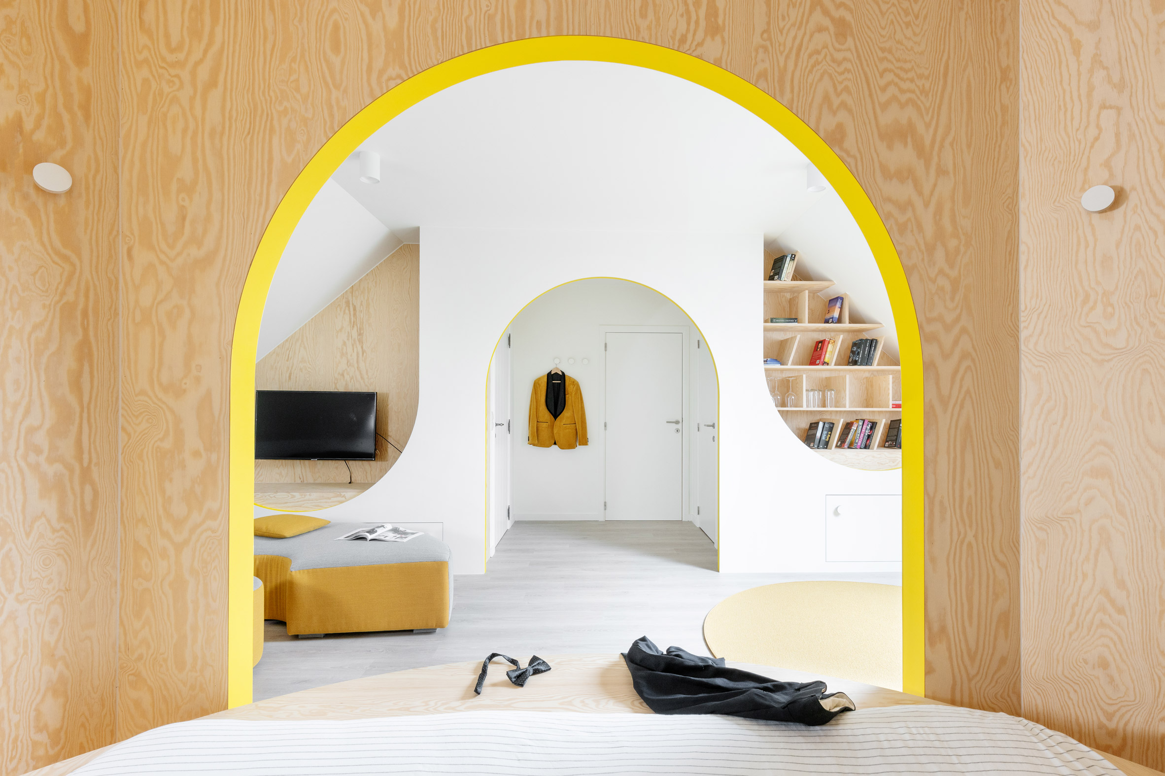 View of a bright room from a sleeping area.