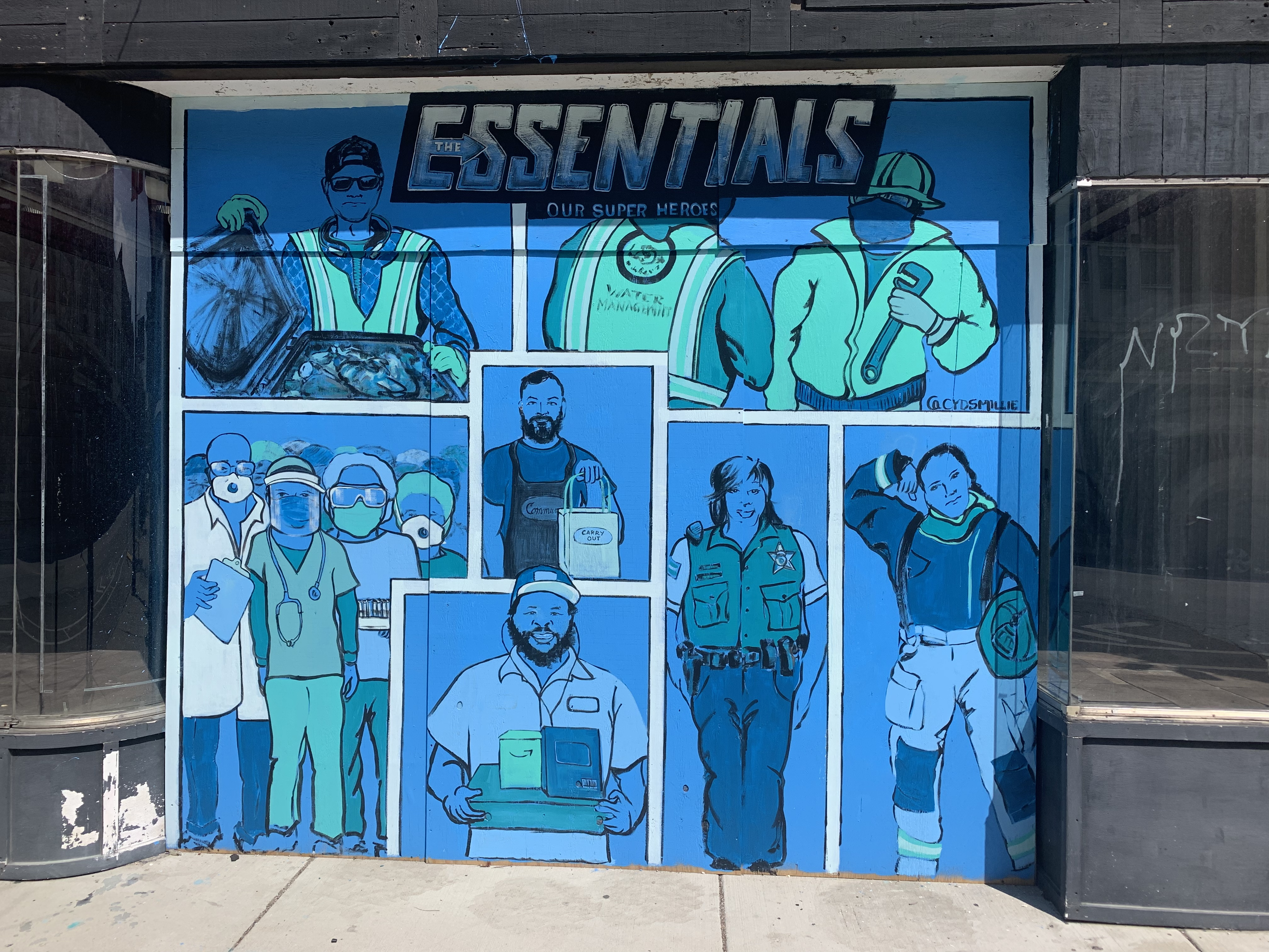 """This mural titled """"The Essentials"""" and painted on a vacant storefront near the Six Corners intersection on the Northwest Side was recently completed by artist Cyd Smillie."""