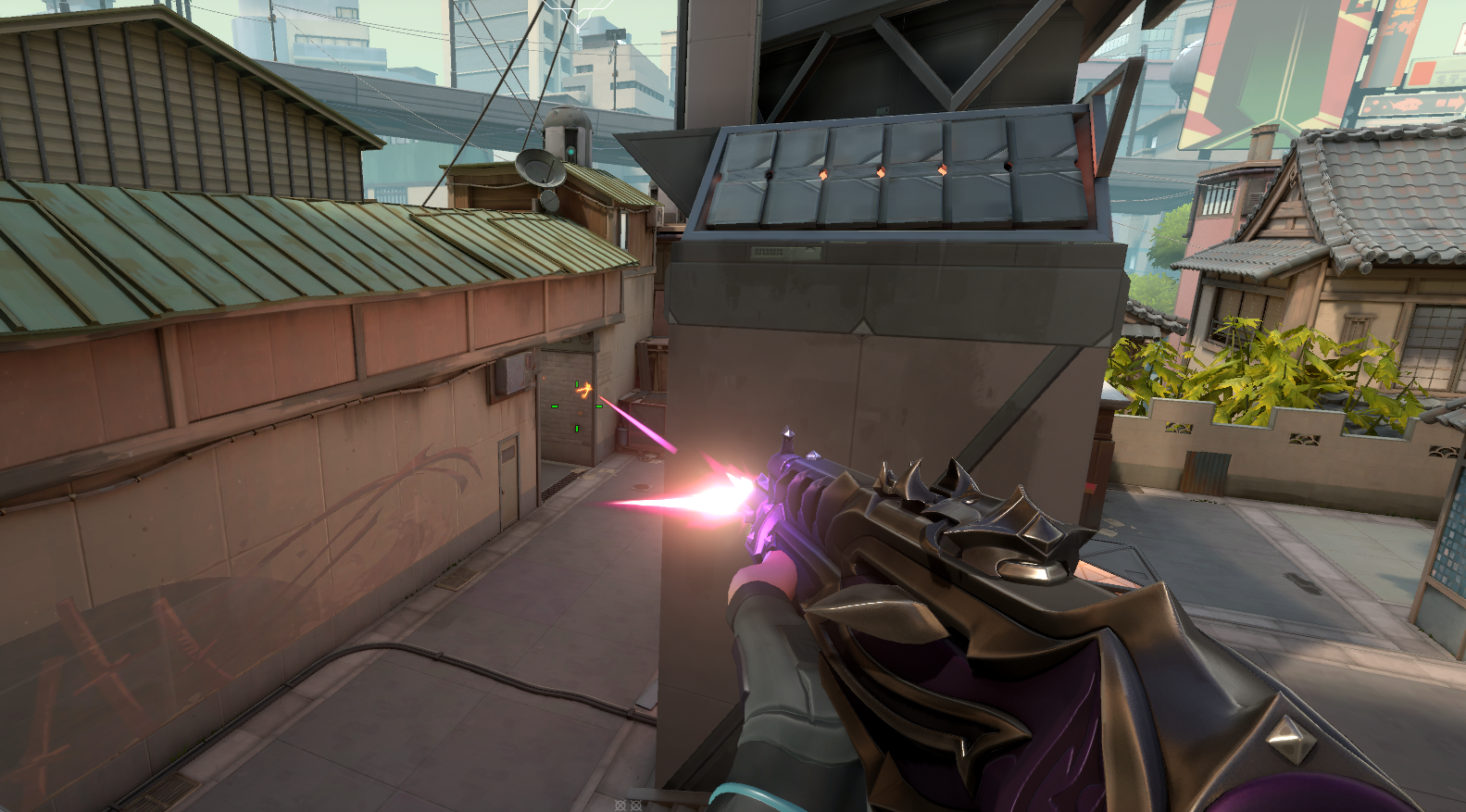 A Valorant player shooting a Vandal with a purple skin on it