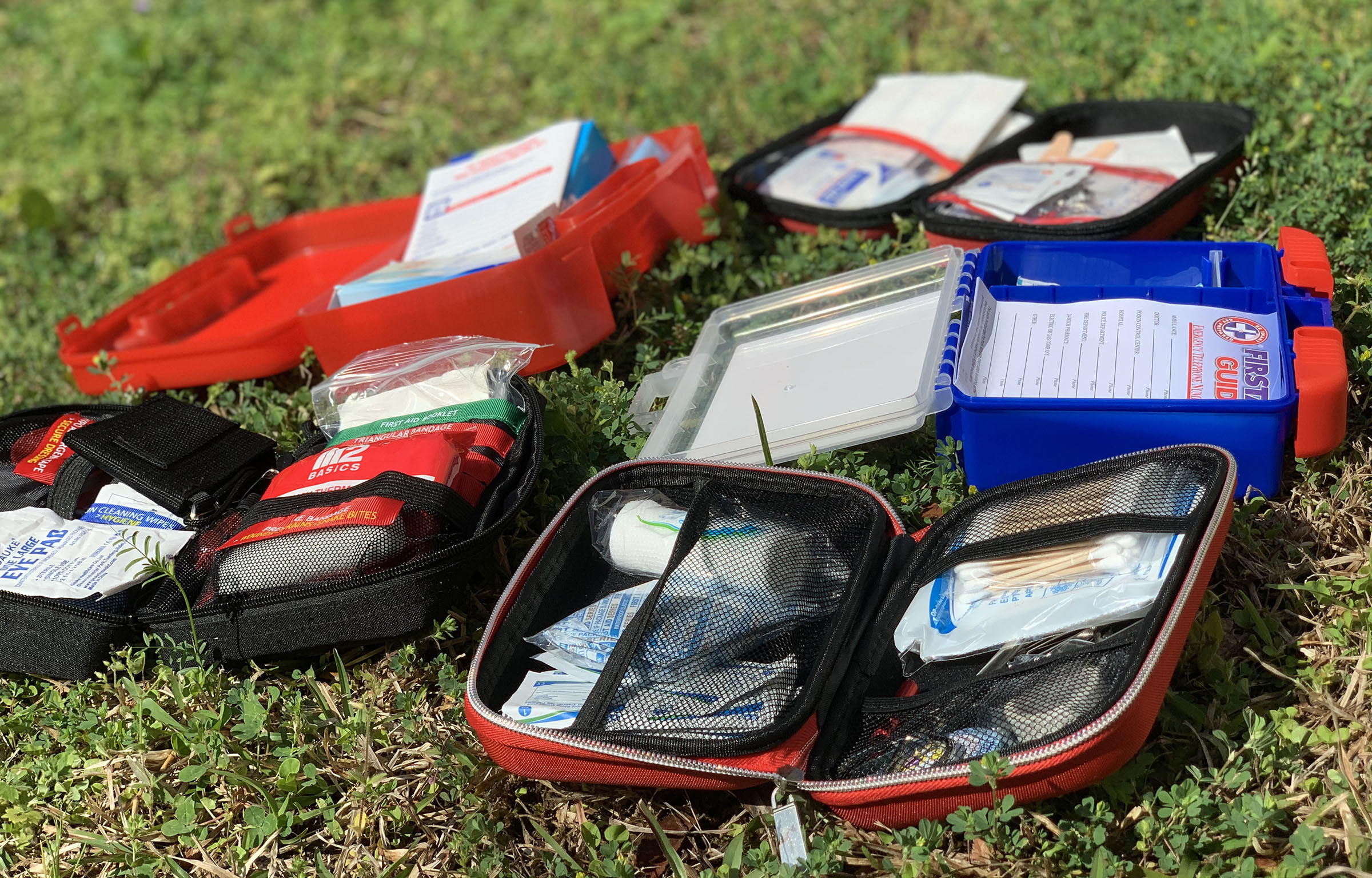 5 First Aid Kits on Grass
