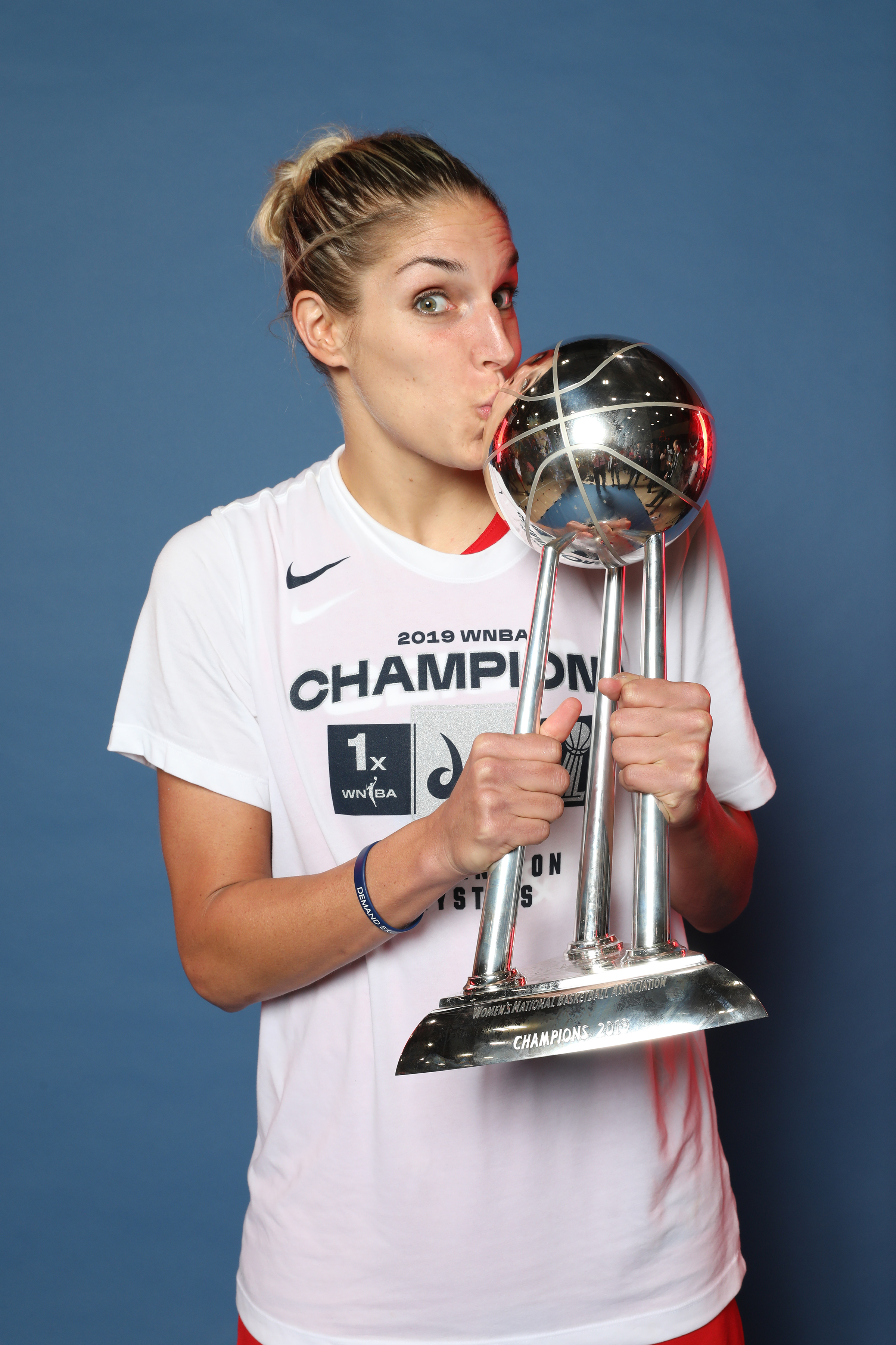 Elena Delle Donne of Washington Mystics smiles with the trophy after winning Game Five of the 2019 WNBA Finals on October 10, 2019 at the St. Elizabeths East Entertainment and Sports Arena in Washington, DC.