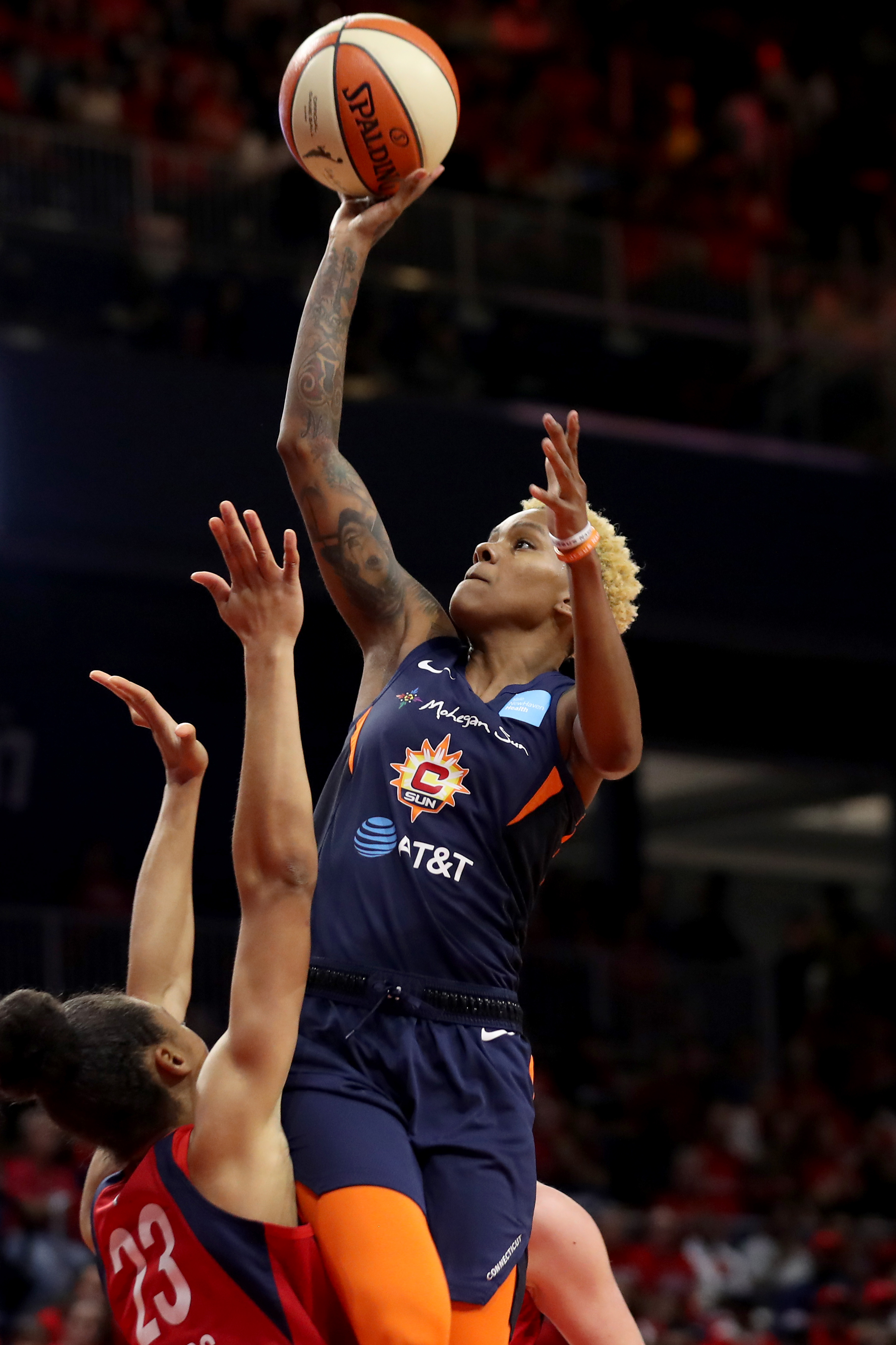 Courtney Williams of Connecticut Sun shoots over Aerial Powers of the Washington Mystics in the first half during Game Five of the 2019 WNBA Finals at St Elizabeths East Entertainment & Sports Arena on October 10, 2019 in Washington, DC.