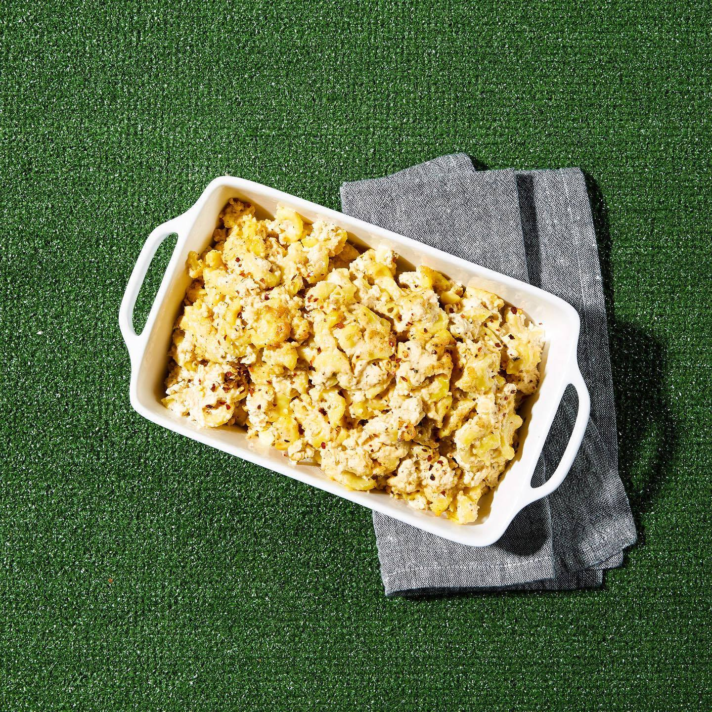 Plum Bistro's mac 'n' cheese twist known as Mac & Yease against a green turf background.
