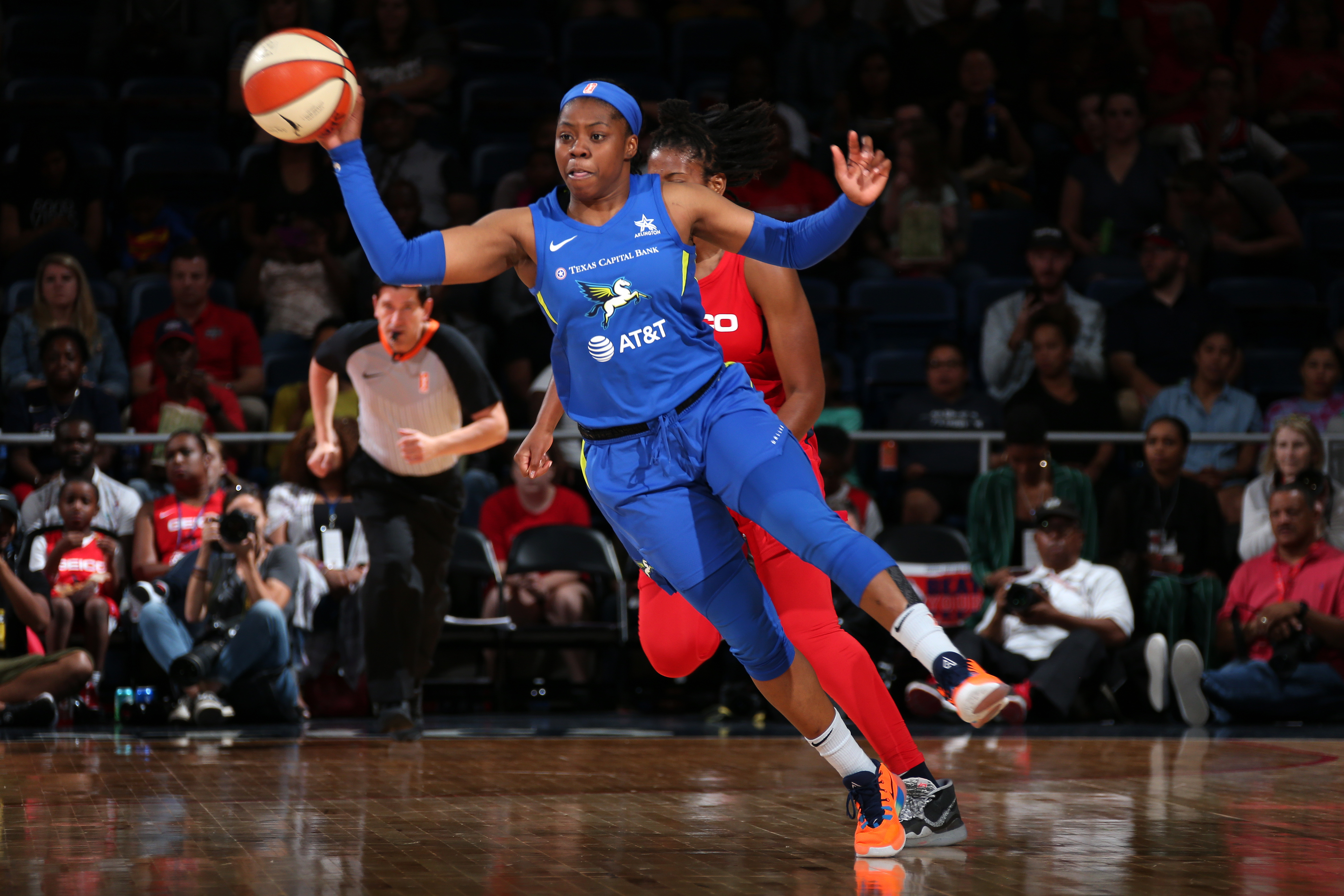 Arike Ogunbowale of the Dallas Wings passes the ball against the Washington Mystics on September 6, 2019 at the St. Elizabeths East Entertainment and Sports Arena in Washington, DC.