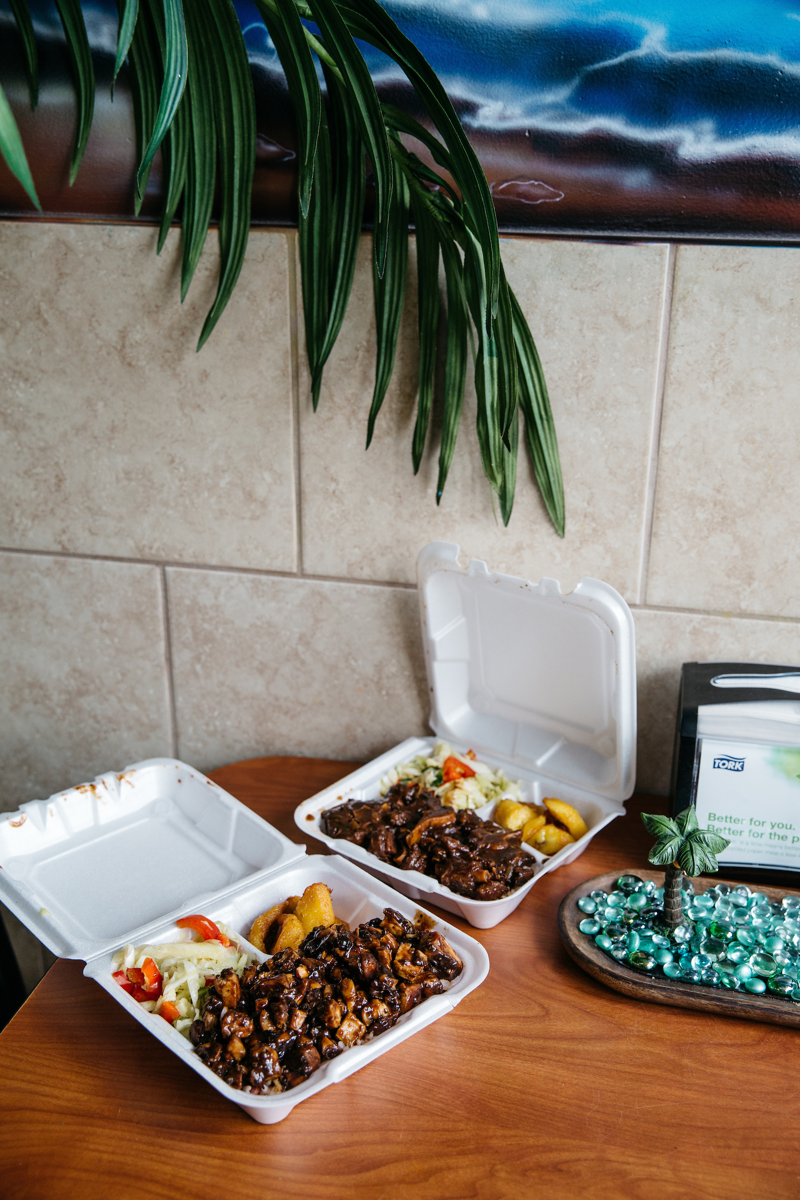 Carryout containers filled with food from the Jamaican Pot.