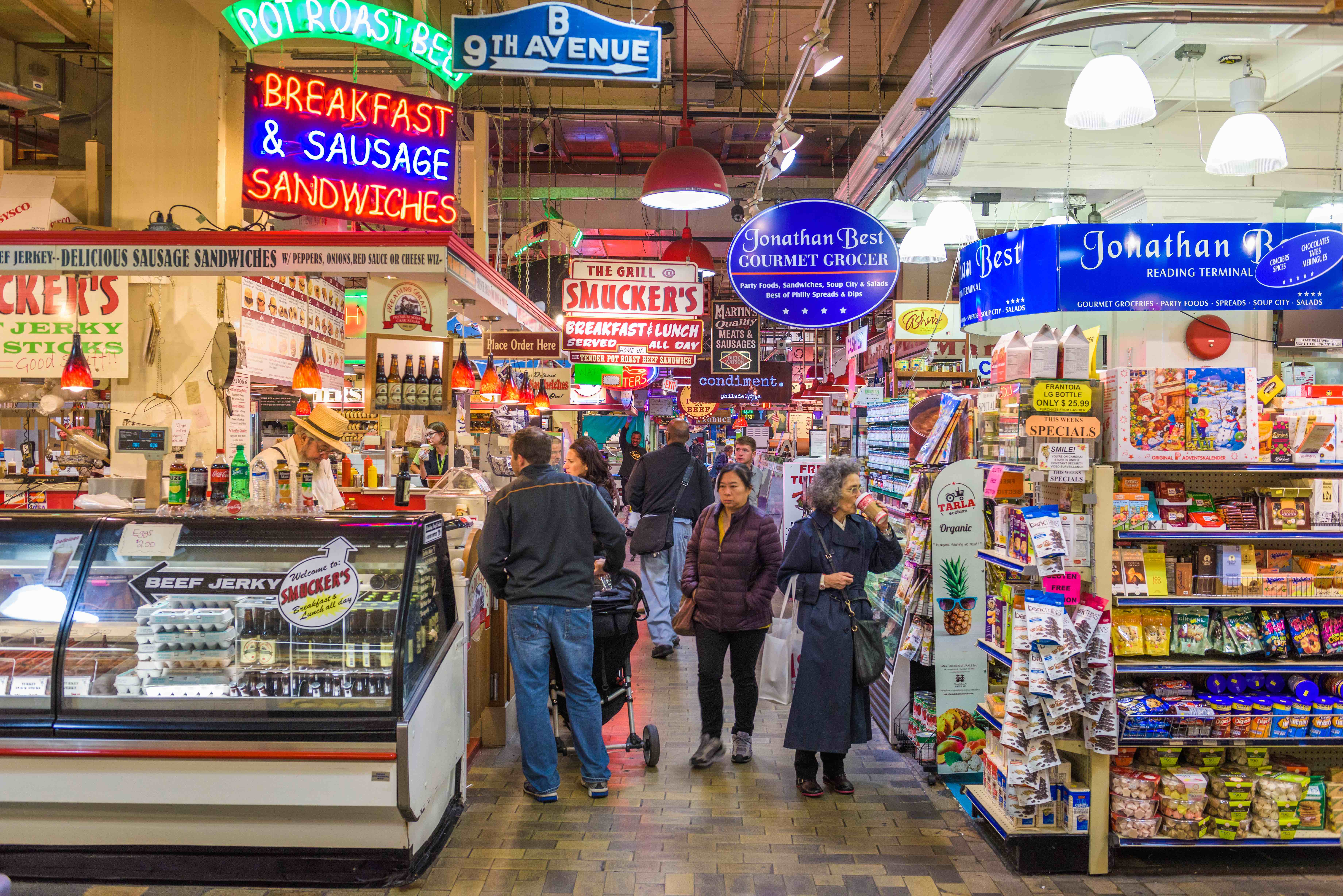 food market with grocery stalls and neon signs