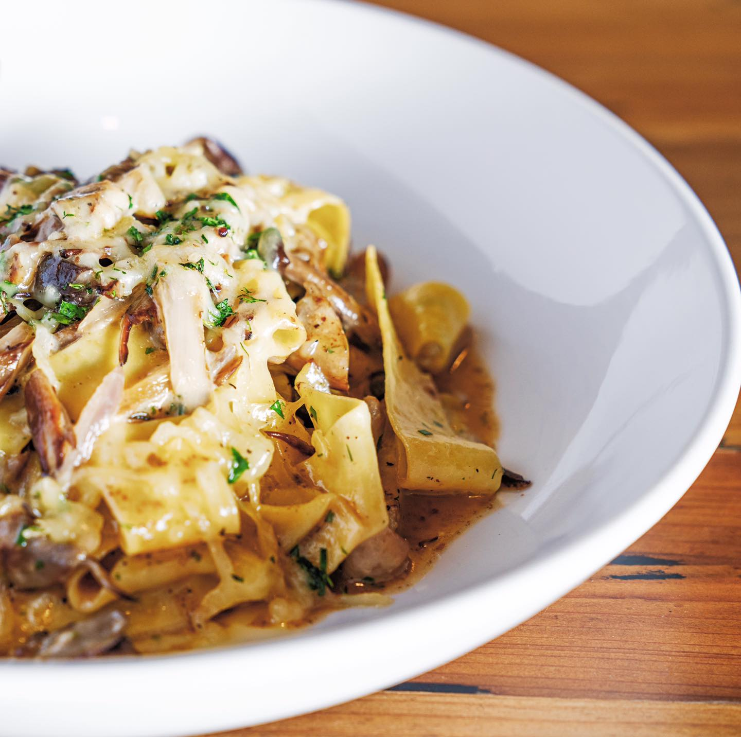 Pappardelle pasta with chicken, mushrooms, and truffle cheese fondue