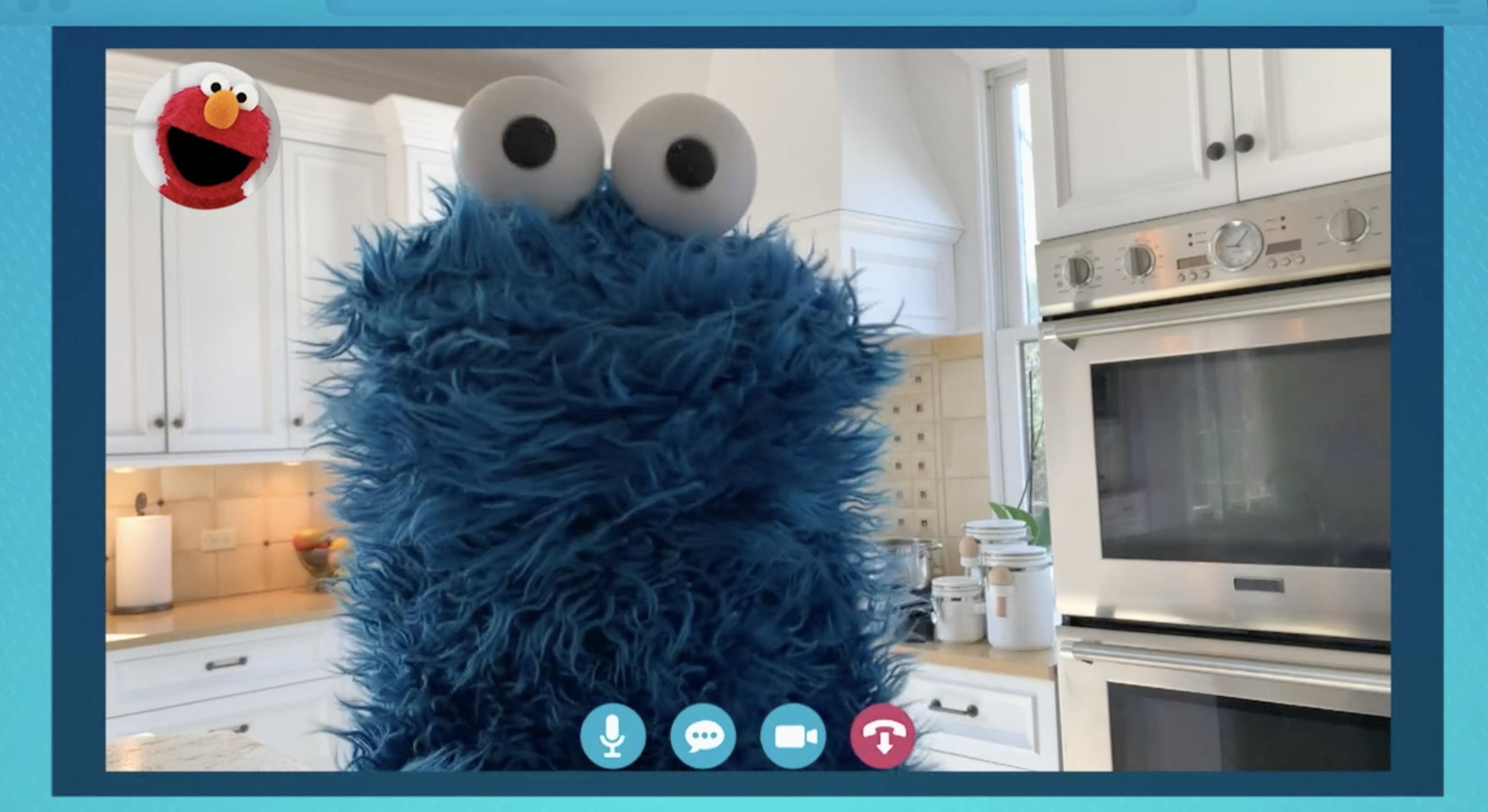 Cookie Monster teleconferences with Elmo from his kitchen, in Sesame Street: Elmo's Playdate.